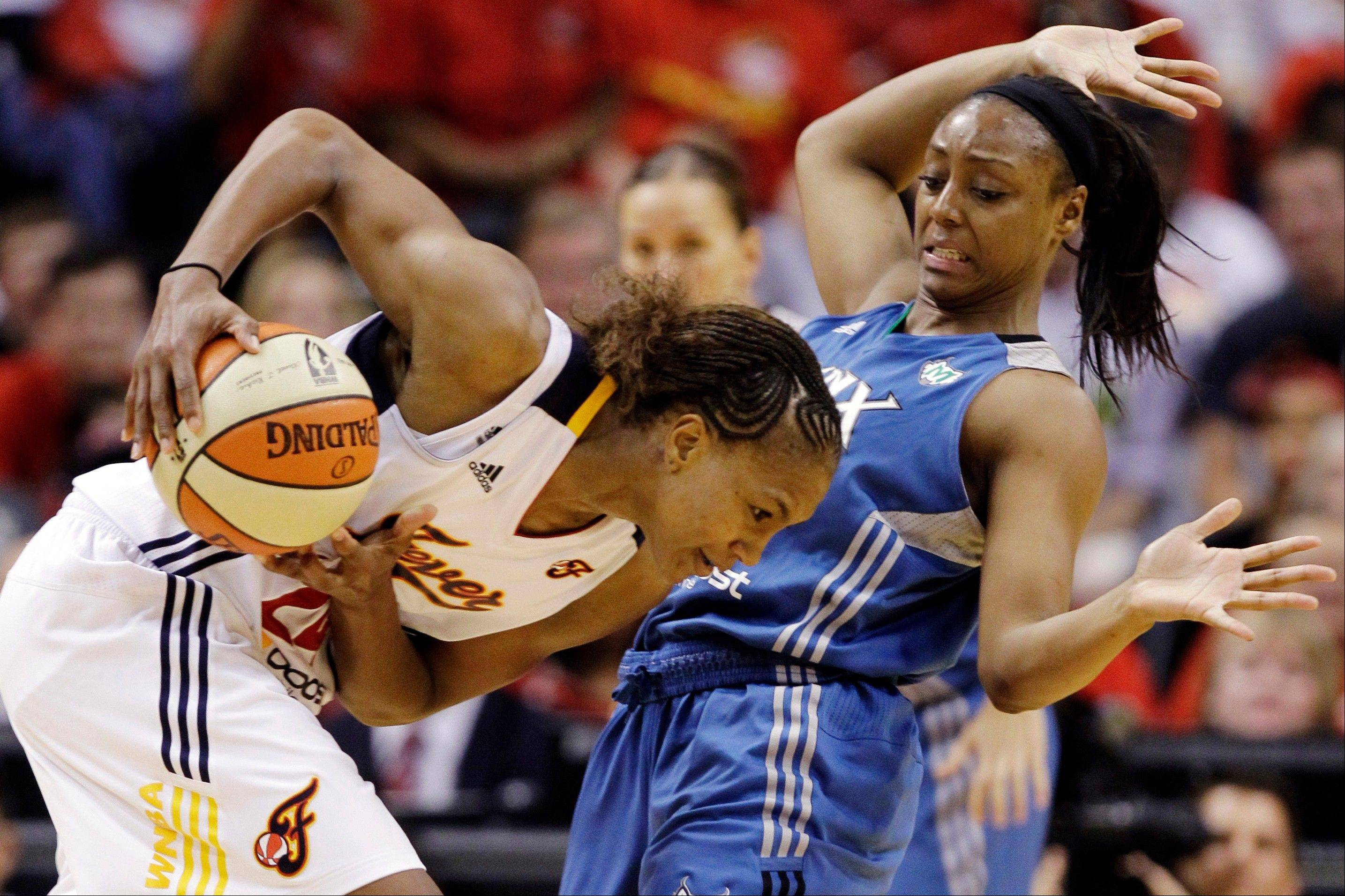 Indiana Fever forward Tamika Catchings, left, tries to make room as she is defended by Minnesota Lynx guard Monica Wright in the third quarter of Game 4 of the WNBA basketball Finals in Indianapolis, Sunday, Oct. 21, 2012.