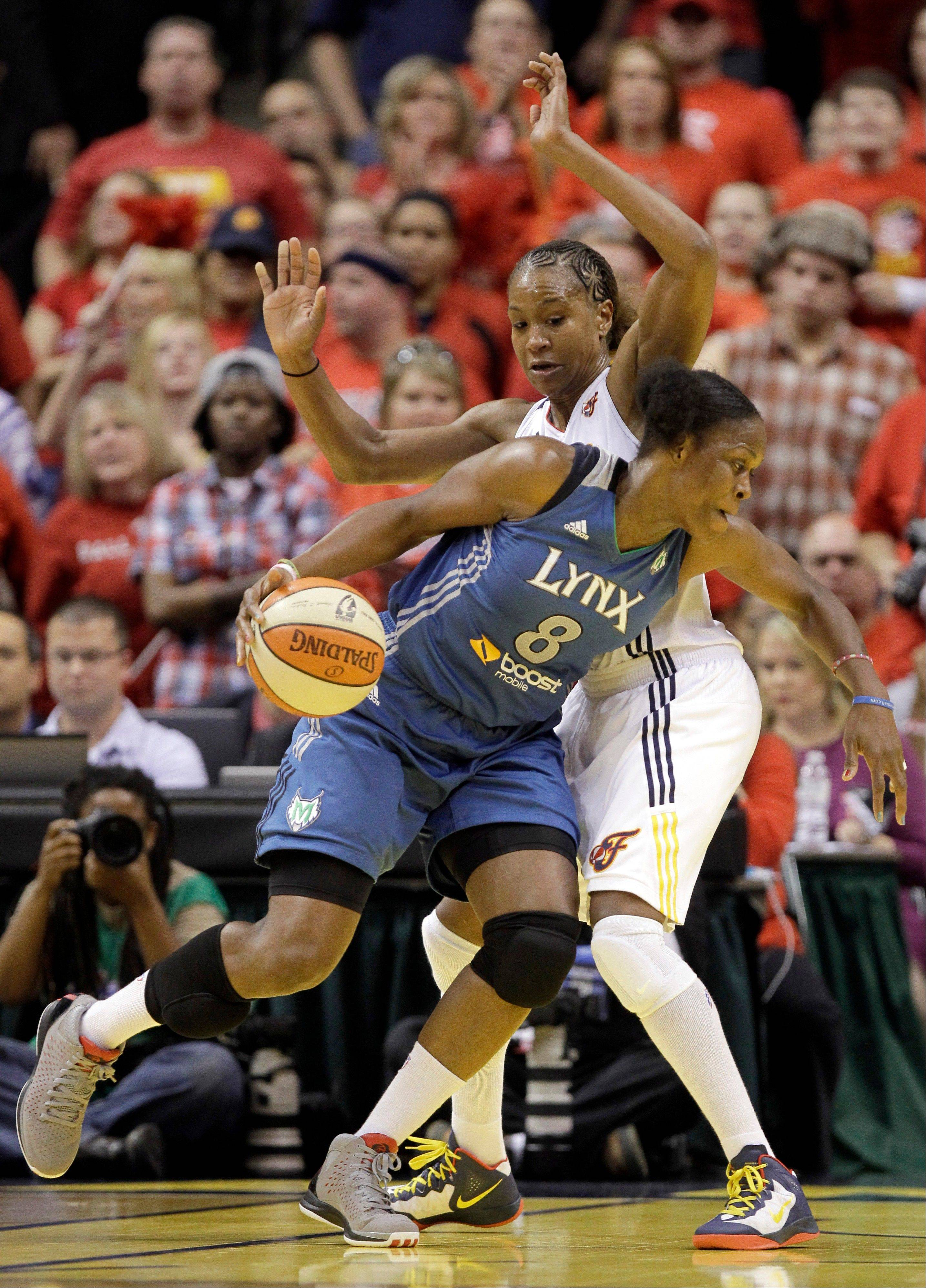 Minnesota Lynx forward Taj McWilliams-Franklin, front, tries to get around Indiana Fever forward Tamika Catchings in the first half of Game Four of the WNBA basketball Finals in Indianapolis, Sunday, Oct. 21, 2012.