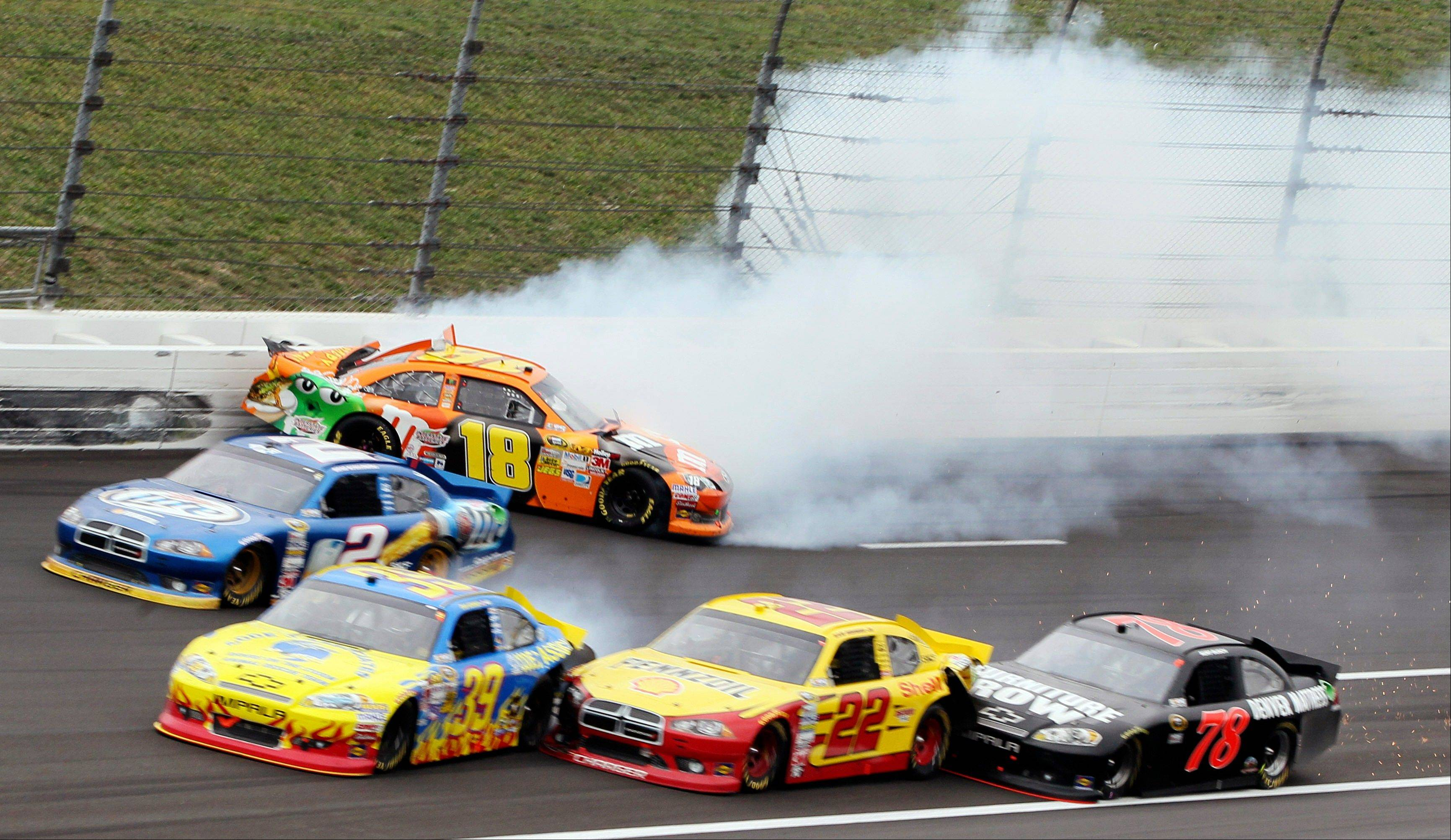 Kyle Busch (18) hits the wall while Brad Keselowski (2), Ryan Newman (39), Sam Hornish Jr. (22) and Kurt Busch (78) tangle trying to avoid the crash Sunday during a NASCAR Sprint Cup Series auto race at Kansas Speedway.