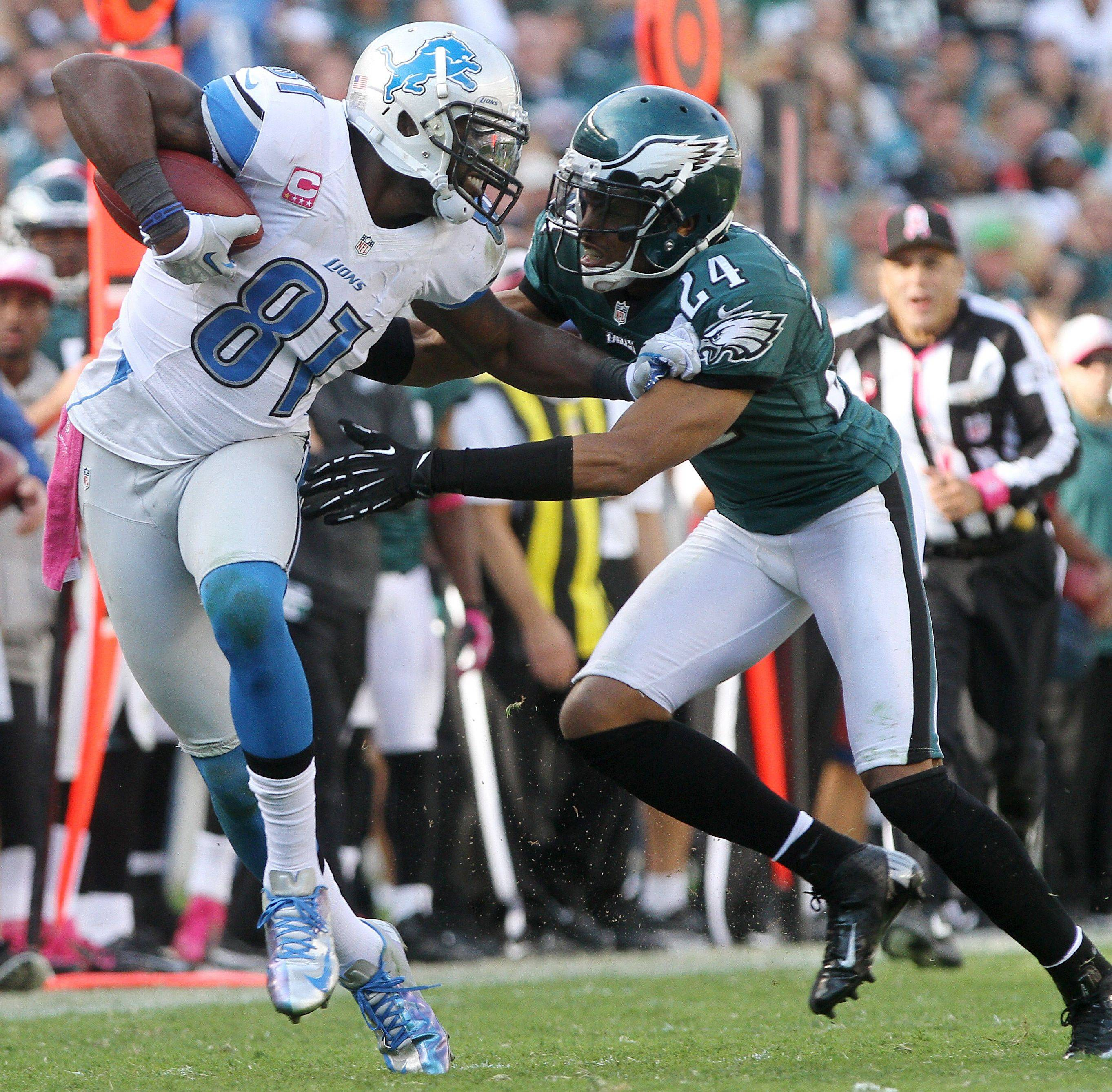 Lions receiver Calvin Johnson tries to separate from Eagles cornerback Nnamdi Asomugha last week in Philadelphia. Johnson has 35 catches for 558 yards and 1 TD on the season.