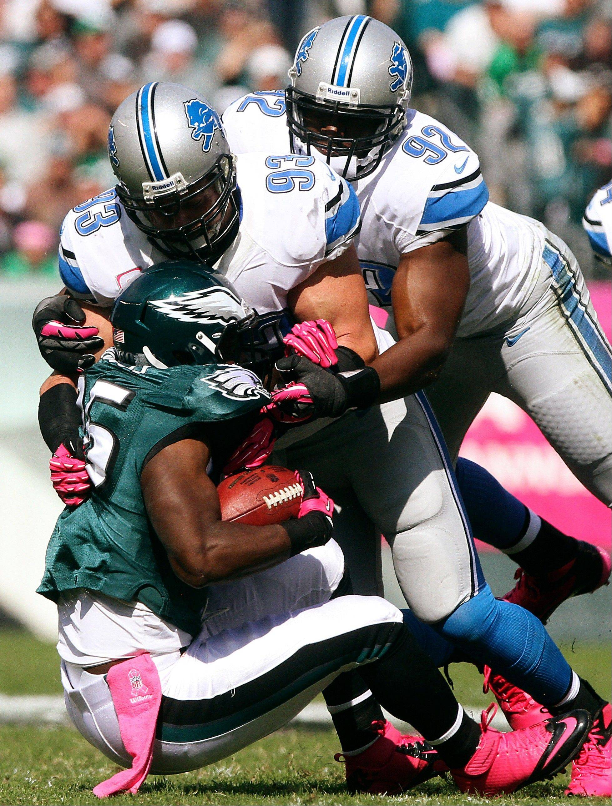 Eagles running back LeSean McCoy is tackled by Detroit Lions defensive linemen Kyle Vanden Bosch (93) and Cliff Avril last week. Avril leads the Lions with 3.5 sacks.