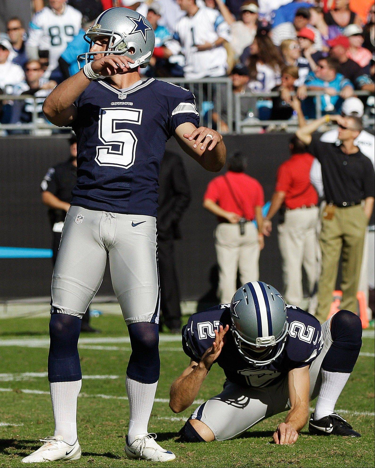 Dallas kicker Dan Bailey watches his second field goal of the fourth quarter alongside Brian Moorman on Sunday against the Panthers in Charlotte, N.C.