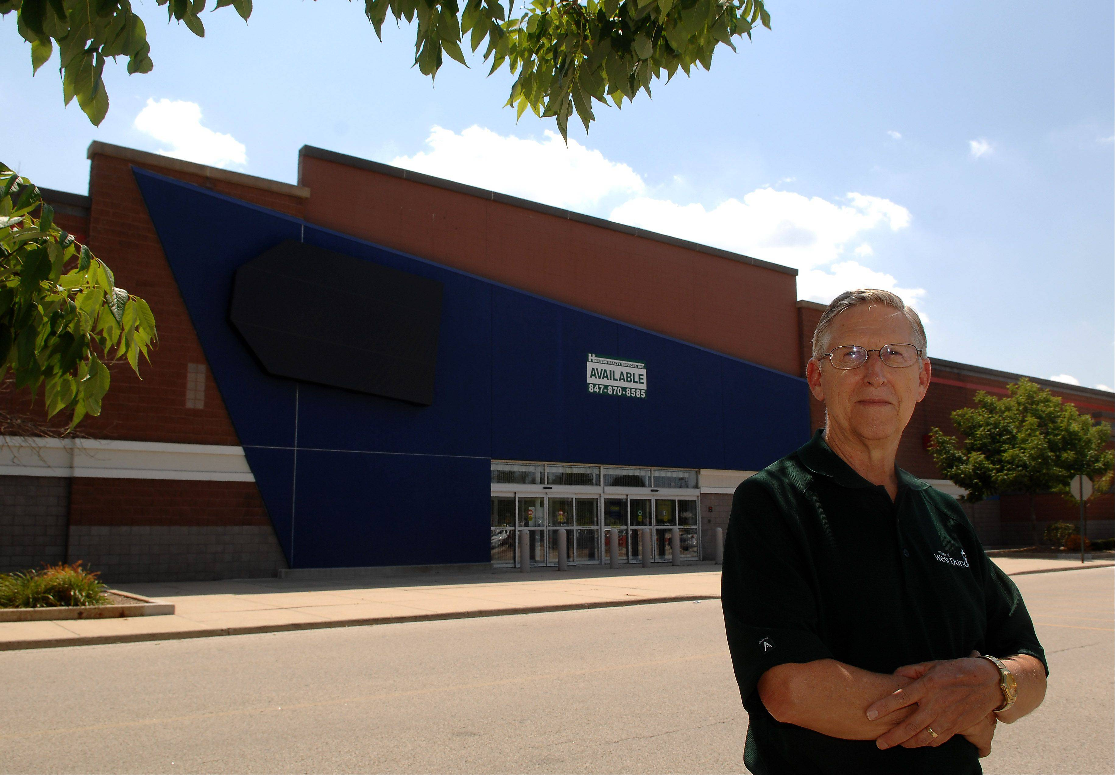 West Dundee Village President Larry Keller in the lot of his village�s recently shuttered Best Buy store. Best Buy had generated about $400,000 in sales tax.