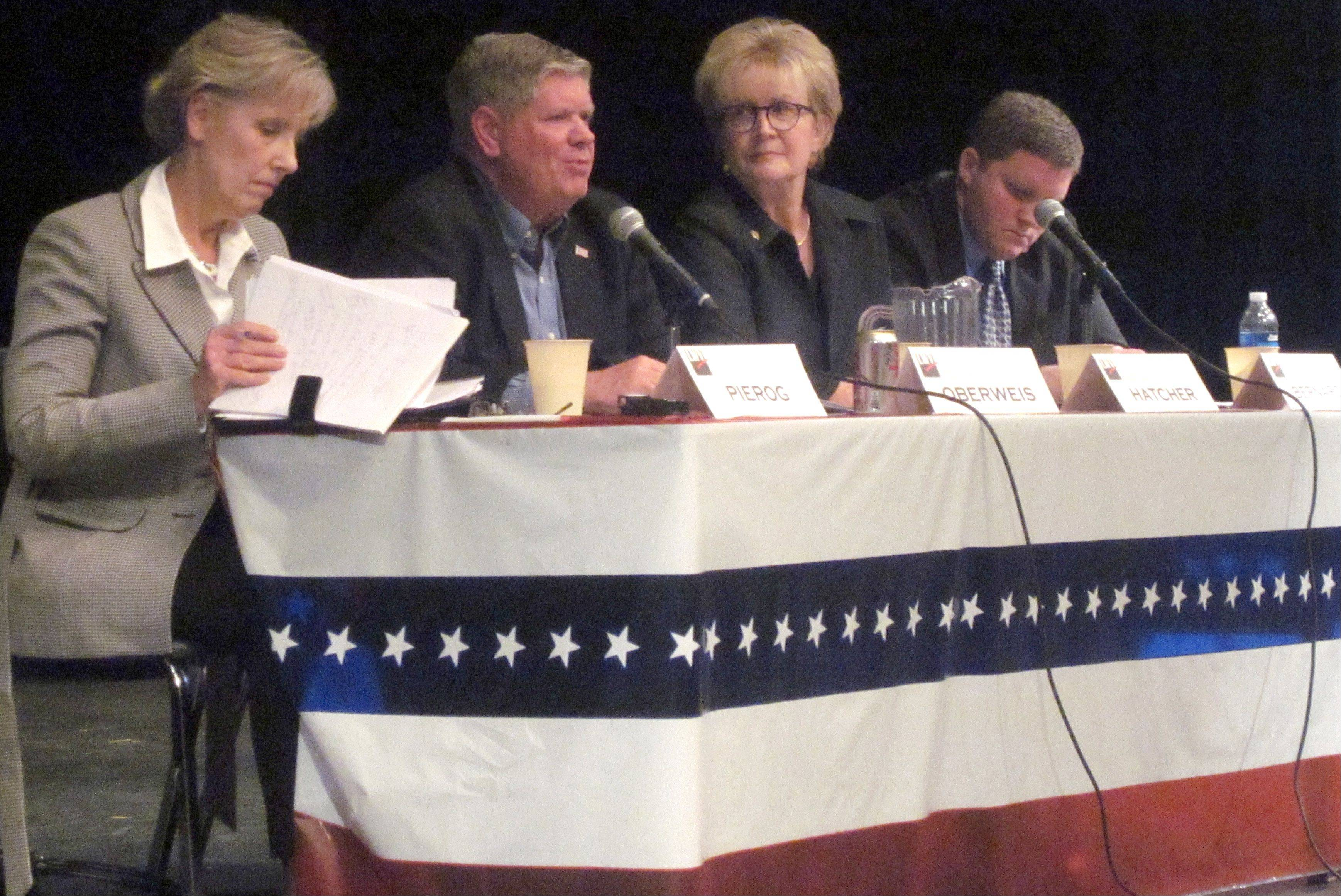 Corinne Pierog, left, Democratic candidate for the state 25th Senate District; Republican Jim Oberweis, her opponent; state Rep. Kay Hatcher, a Republican seeking re-election to the 50th House seat; and Democrat Andrew Bernard, her opponent, answer questions at a League of Women Voters of Central Kane County forum Monday in Geneva.