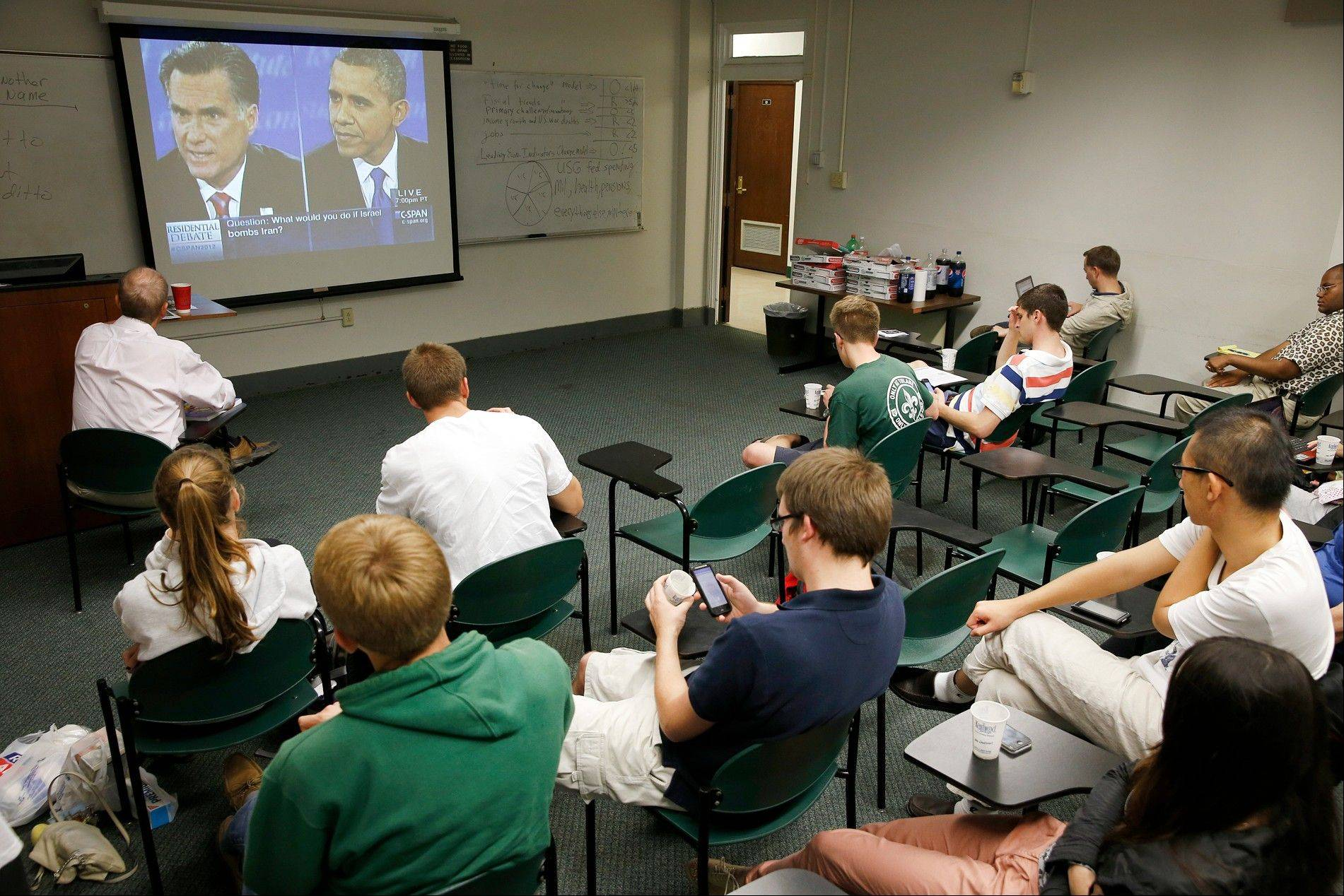 A group of Tulane University students watch the third presidential debate at Tulane University in New Orleans on Monday. Tulane�s political science department sponsored the event.
