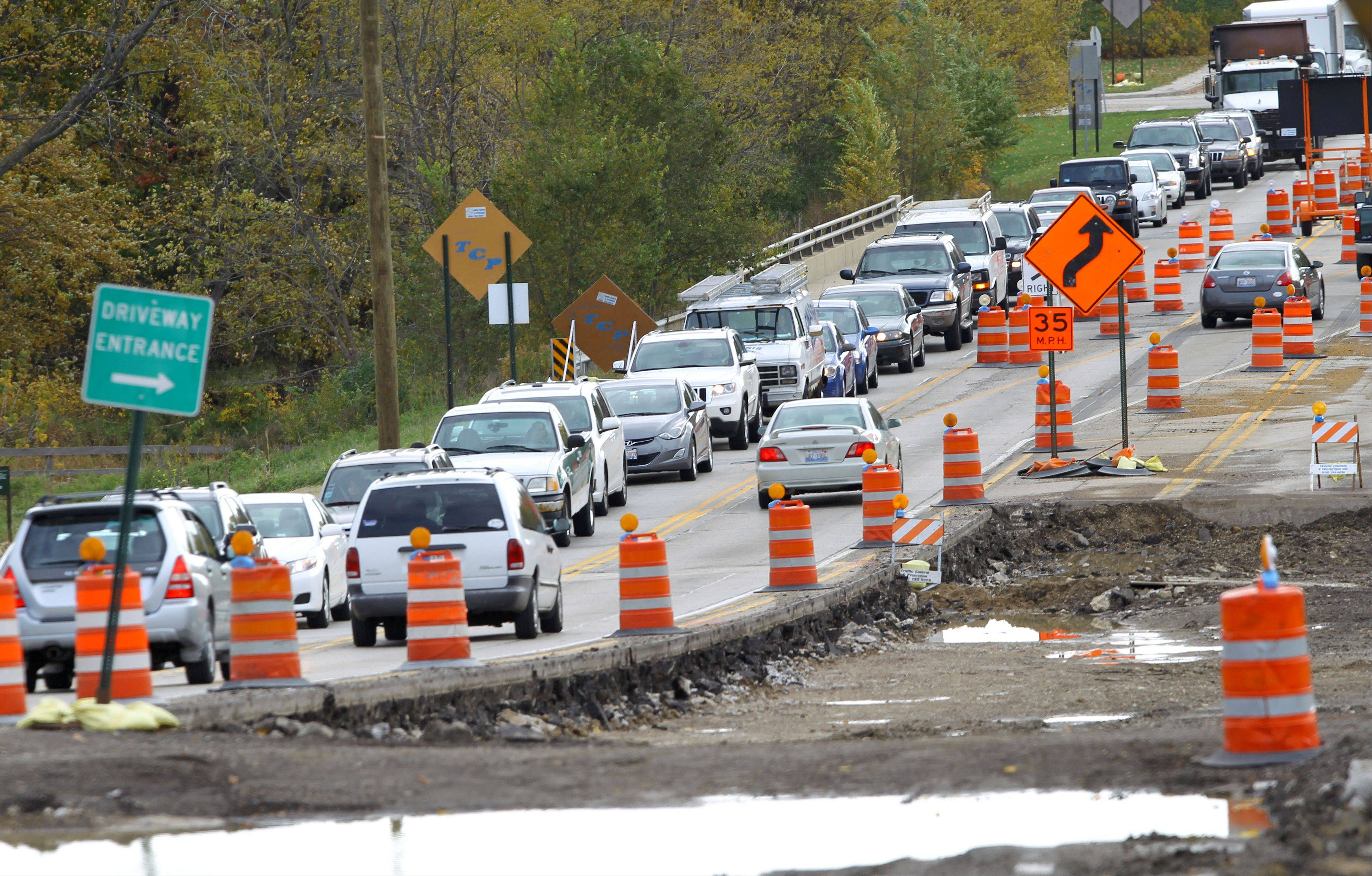 Westbound traffic backs up on Route 137 heading toward Milwaukee Avenue in Libertyville, where the road has been narrowed to one lane in each direction during construction. Village leaders and local business affected by the construction are unhappy with the slow rate of progress.