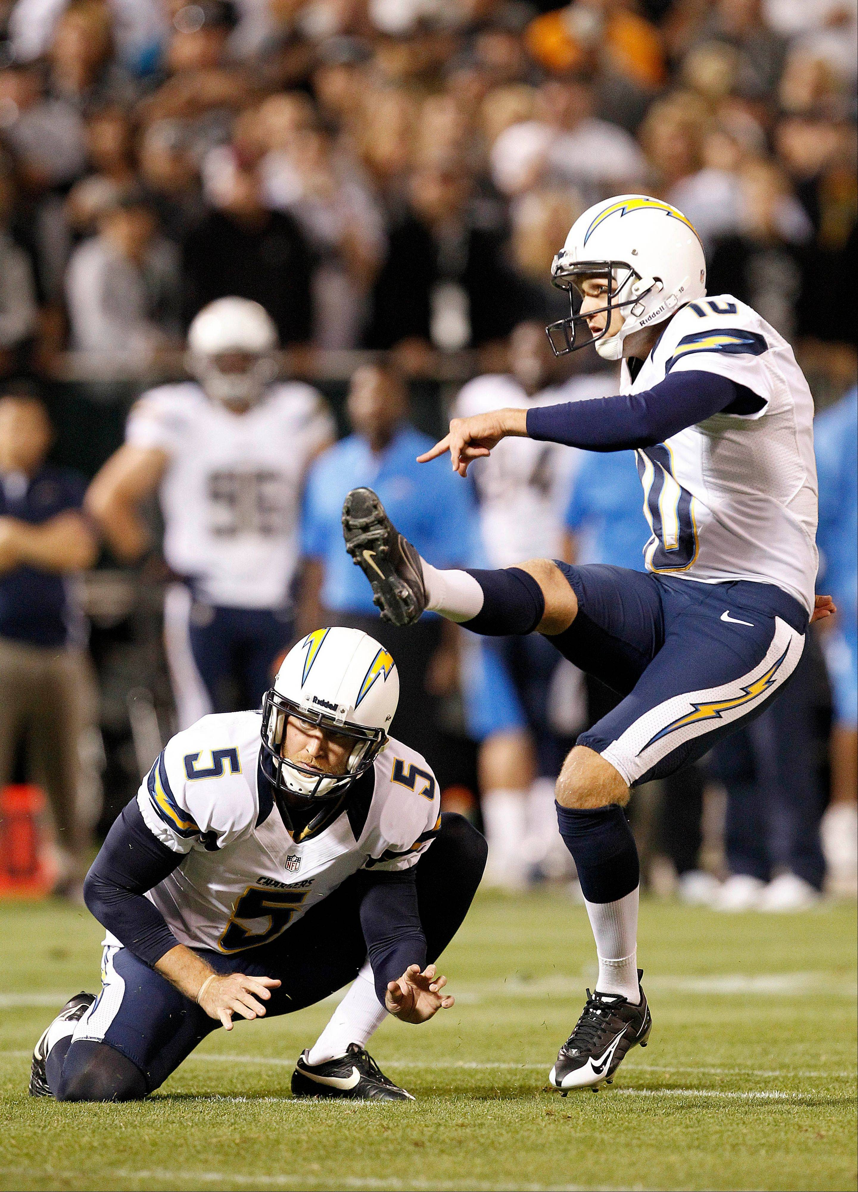 San Diego Chargers kicker Nate Kaeding nails a field goal from the hold of punter Mike Scifres on Sept. 10 against the Oakland Raiders.