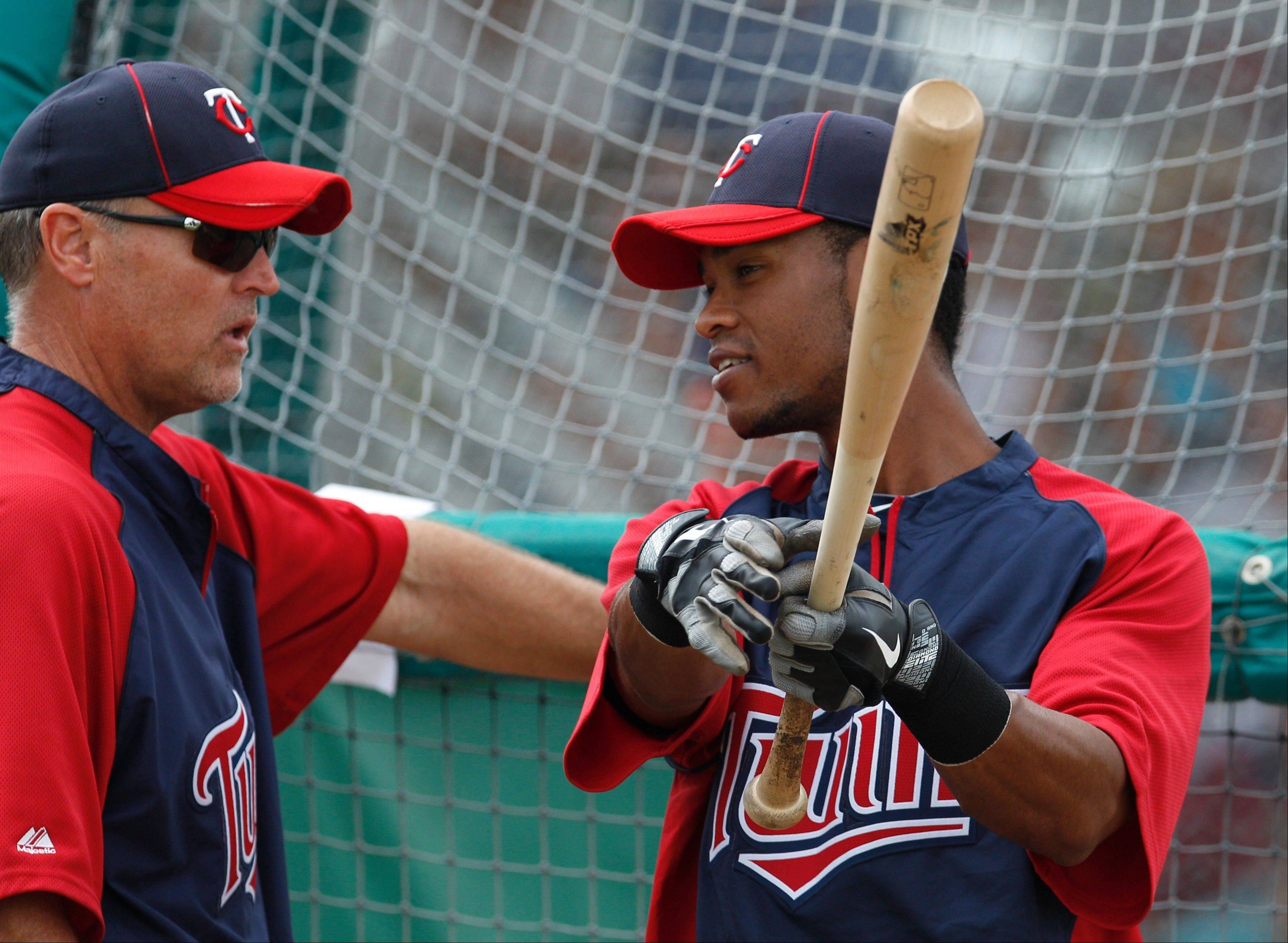 Minnesota Twins Pedro Florimon works with Tom Brunansky during a 2012 spring training session. Brunansky was hired Monday as the new hitting coach for the Twins.