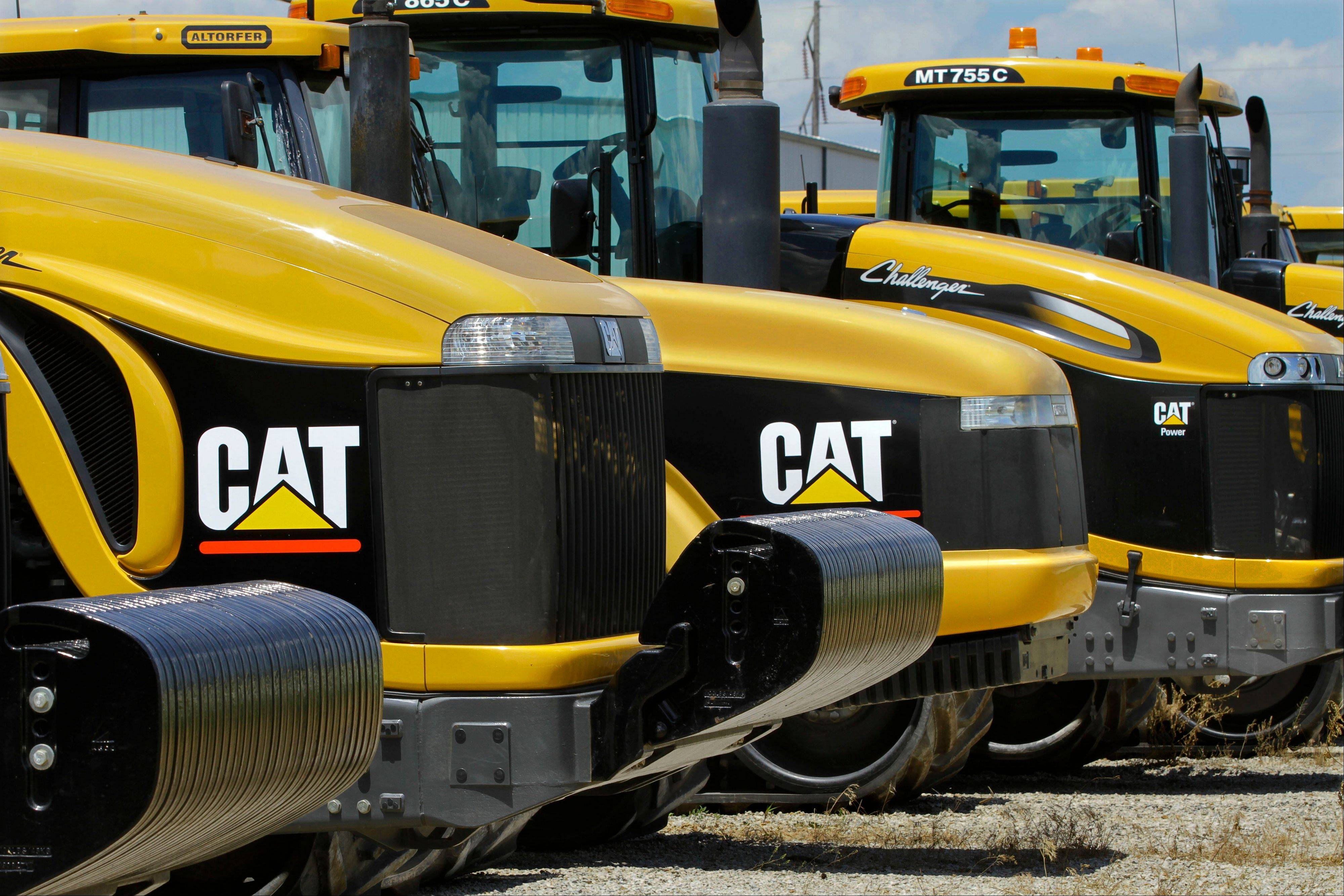 "Peoria-based Caterpillar cut its profit and revenue guidance on Monday, Oct. 22, 2012, saying the world's economic conditions ""are weaker than we had previously expected."""
