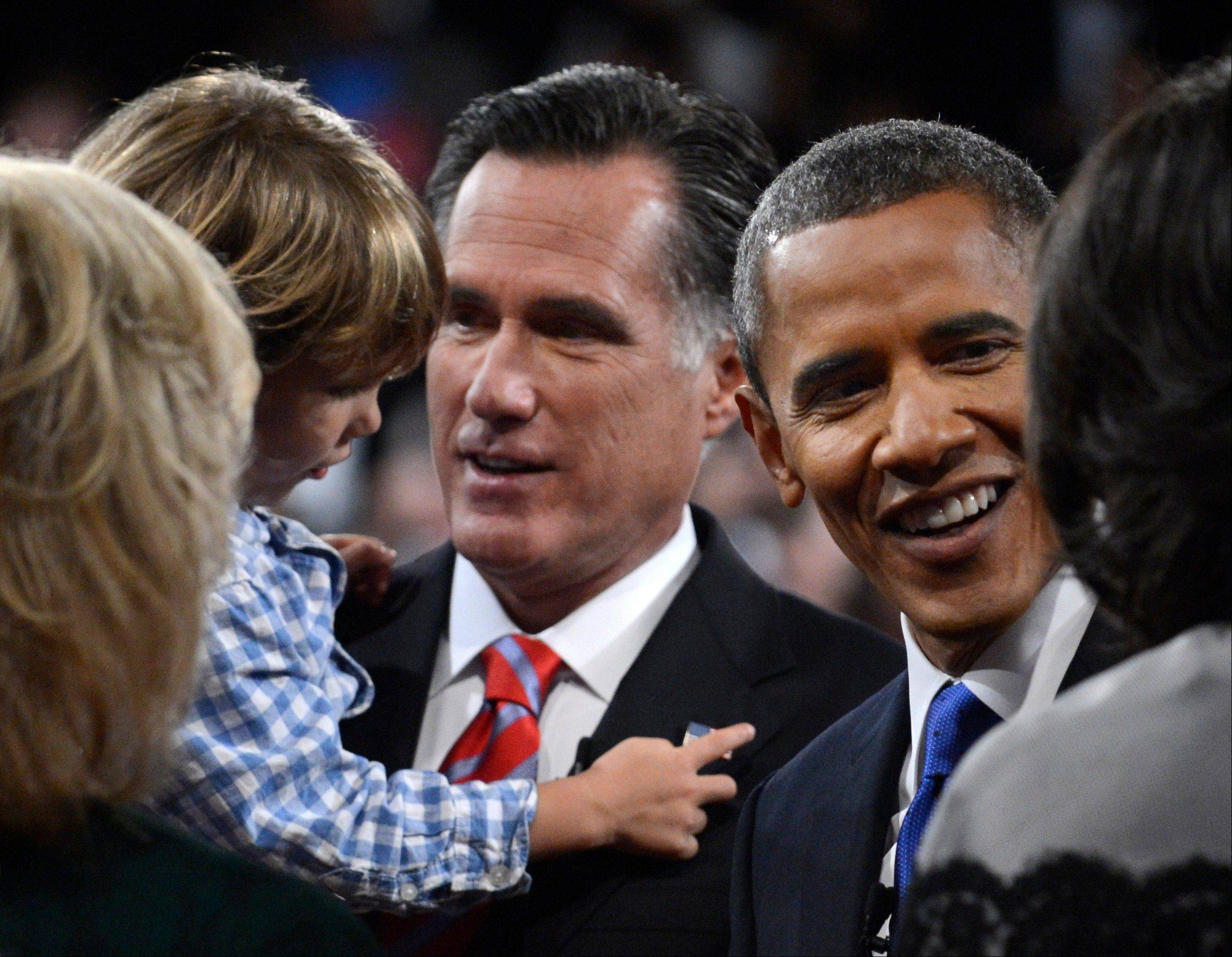 President Barack Obama and Republican presidential nominee Mitt Romney meet family members after the third presidential debate at Lynn University Monday in Boca Raton, Fla.