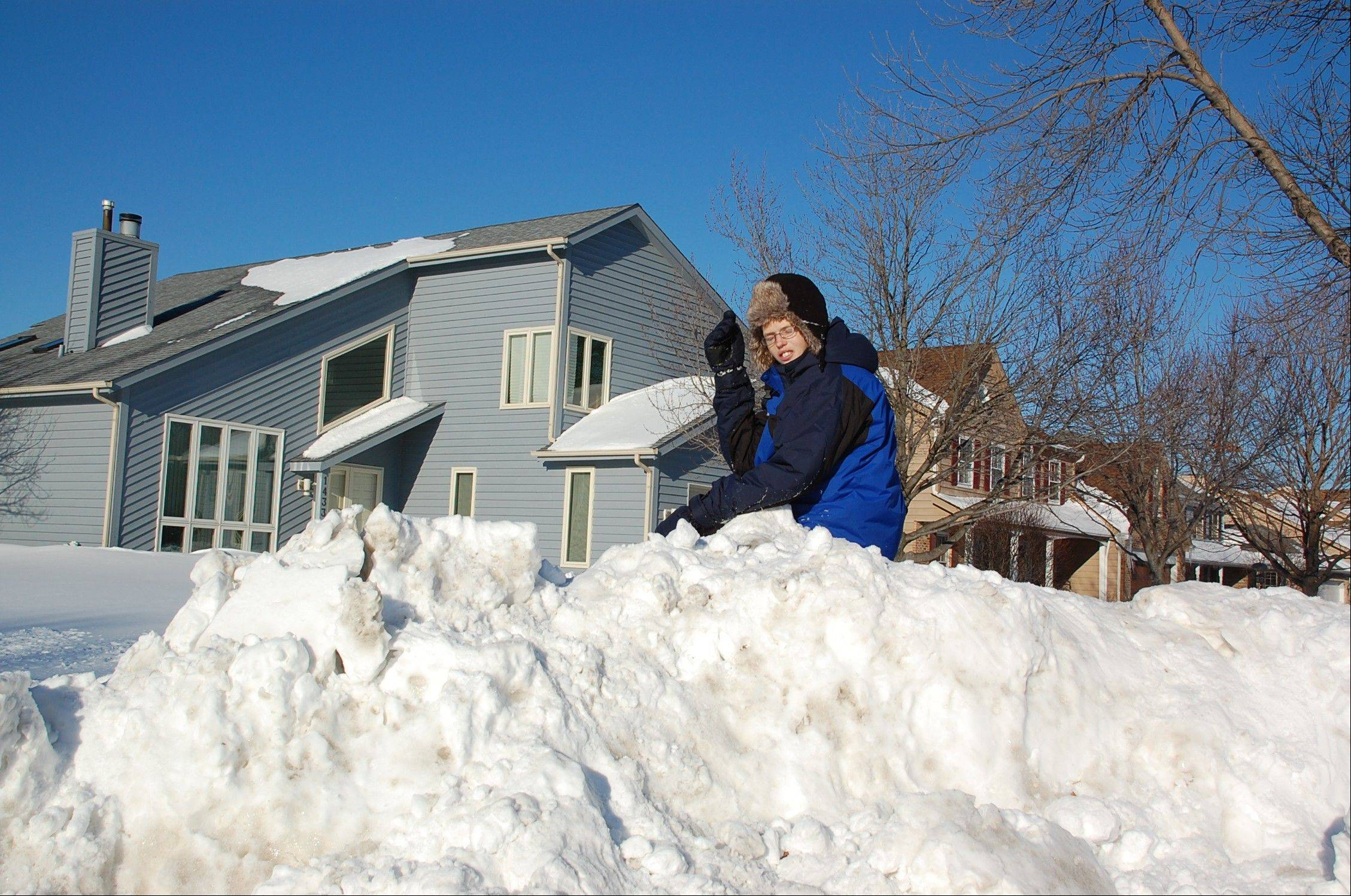 Naperville's Luke Koupal atop a snow bank on Groundhog Day 2011.