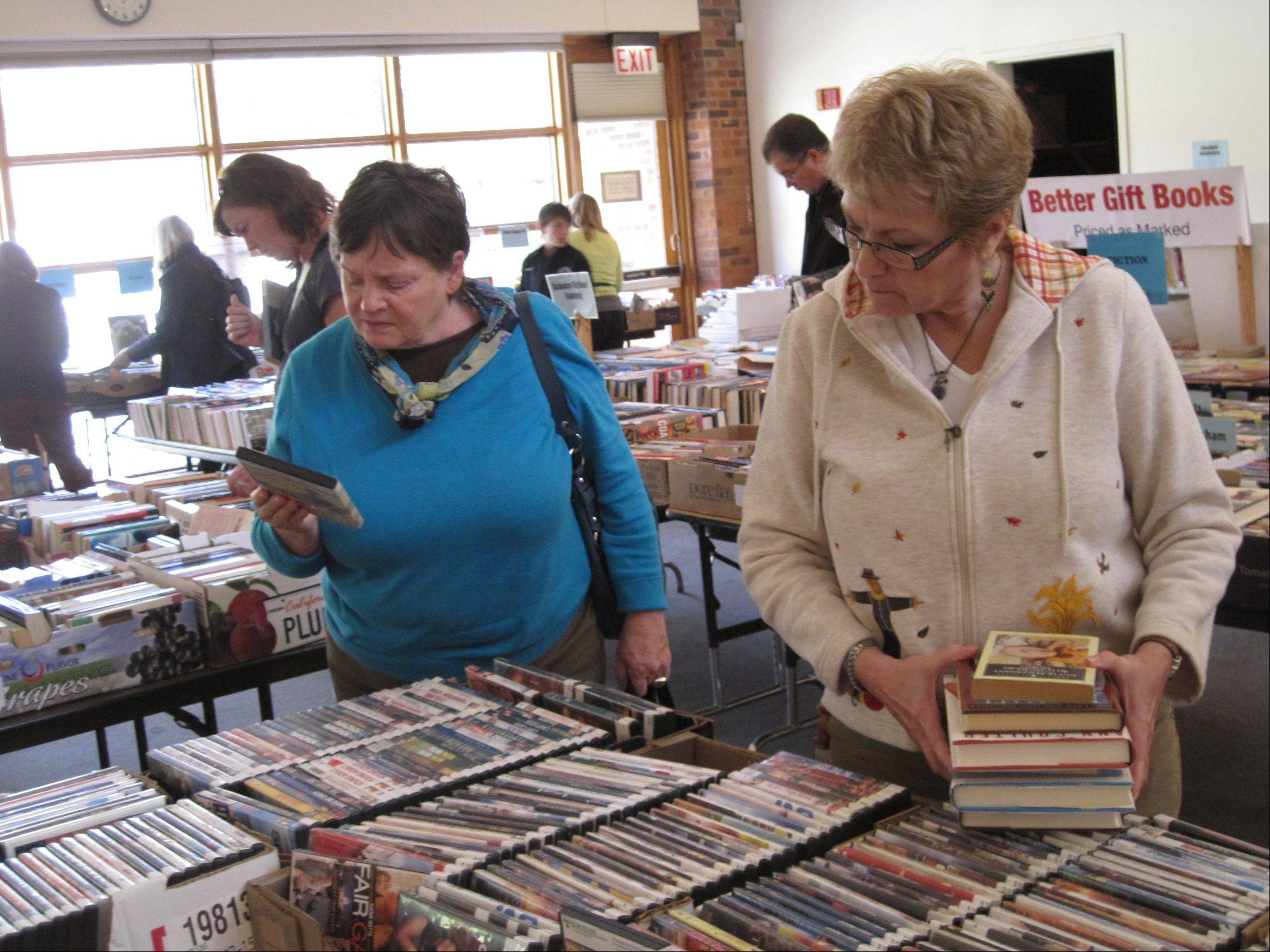 Sue Mertens, of St. Charles, right, attended the Friends of the Barrington Area Library book sale for the first time Saturday. She said she was impressed by how well organized it was.