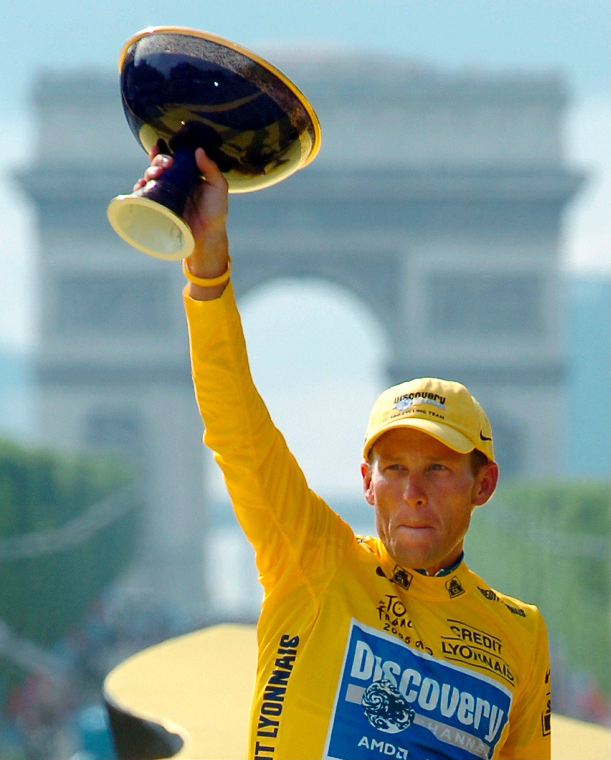 Lance Armstrong, here holding the winner's trophy in 2005 after claiming his seventh straight Tour de France, has been stripped of his titles as upheld by the UCI, the cycling governing body, on Monday.
