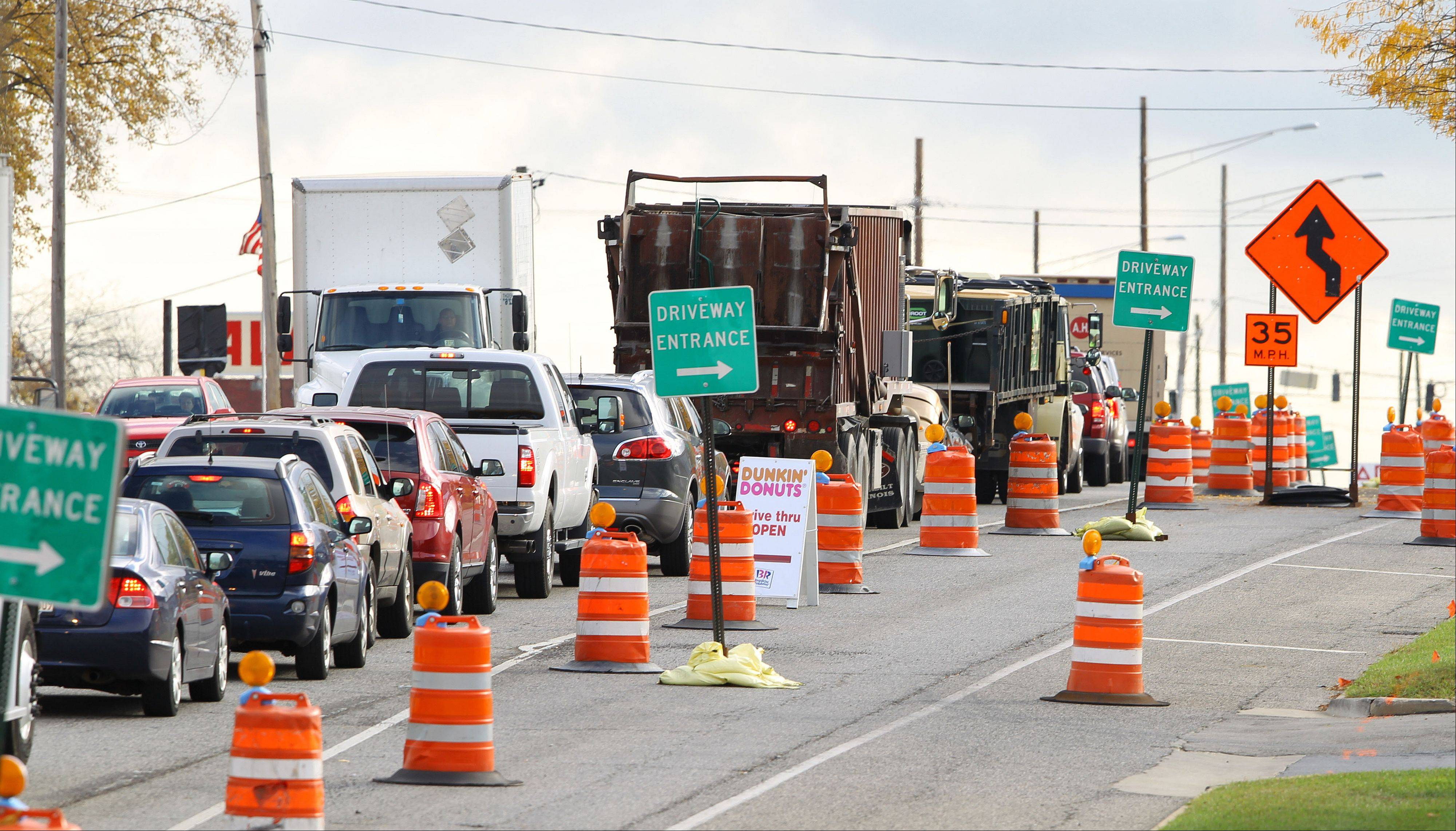 Eastbound traffic on Route 137 approaching Milwaukee Avenue in Libertyville backs up as the road has been narrowed during construction. That configuration will remain in place through winter, a situation that has frustrated village officials and had a negative impact on businesses.