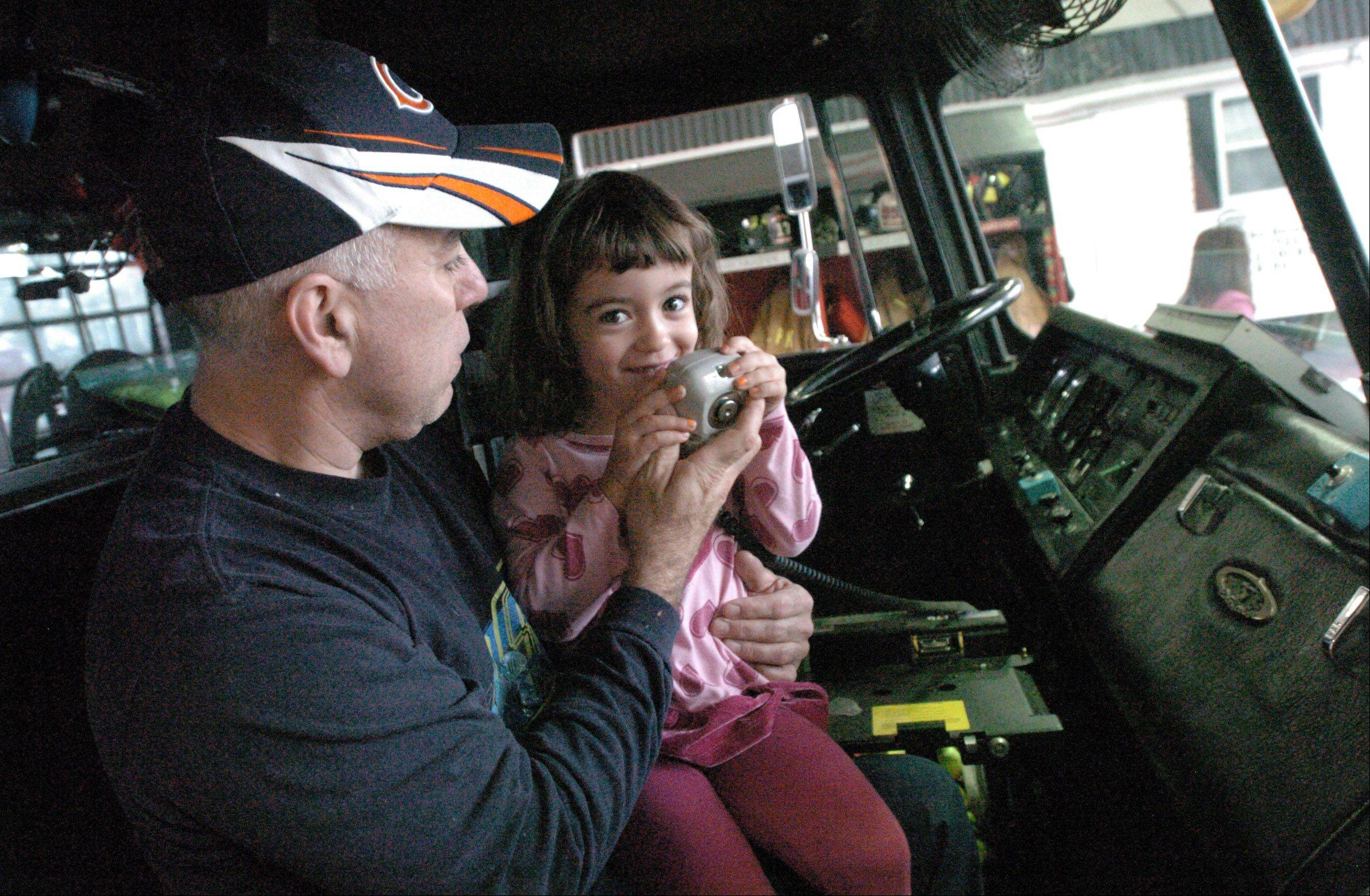 Robert Donofrio and his daughter Amy take a look at a Villa Park fire truck during the open house Saturday. Well over 300 people took part in this event that gave residents a look at what happens at their local fire house.