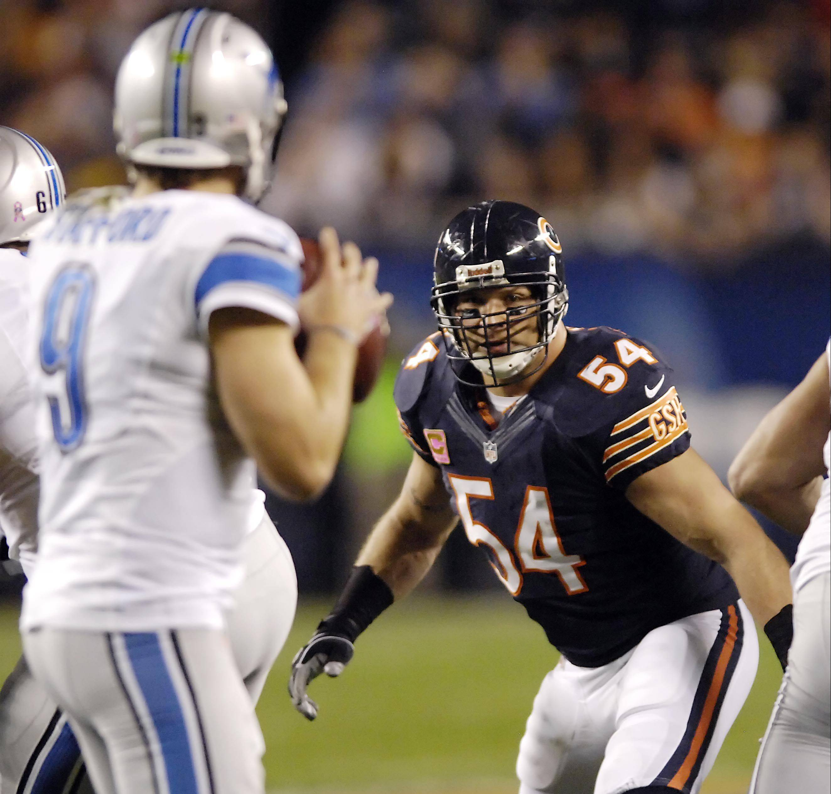 The Bears' Brian Urlacher has Lions QB Matthew Stafford in his sights during the first half at Soldier Field on Monday. Stafford was forced to scramble and was sacked by Julius Peppers.