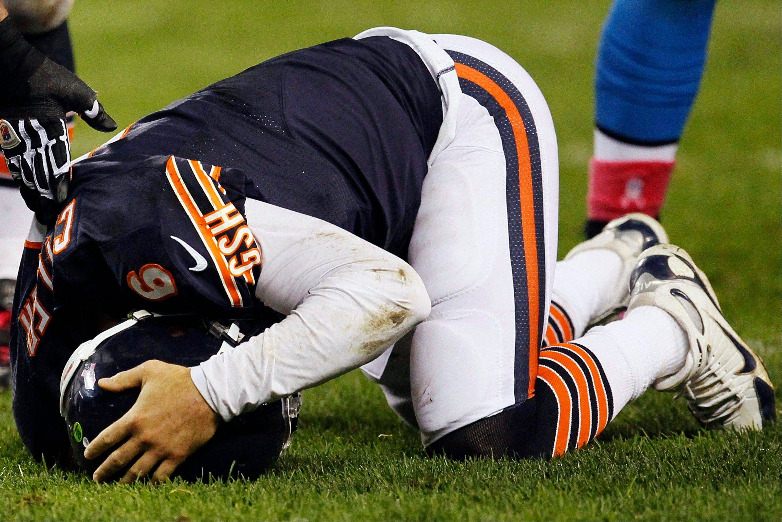 Bears quarterback Jay Cutler holds his head after being sacked by Lions defensive tackle Ndamukong Suh in the first half Monday night at Soldier Field.
