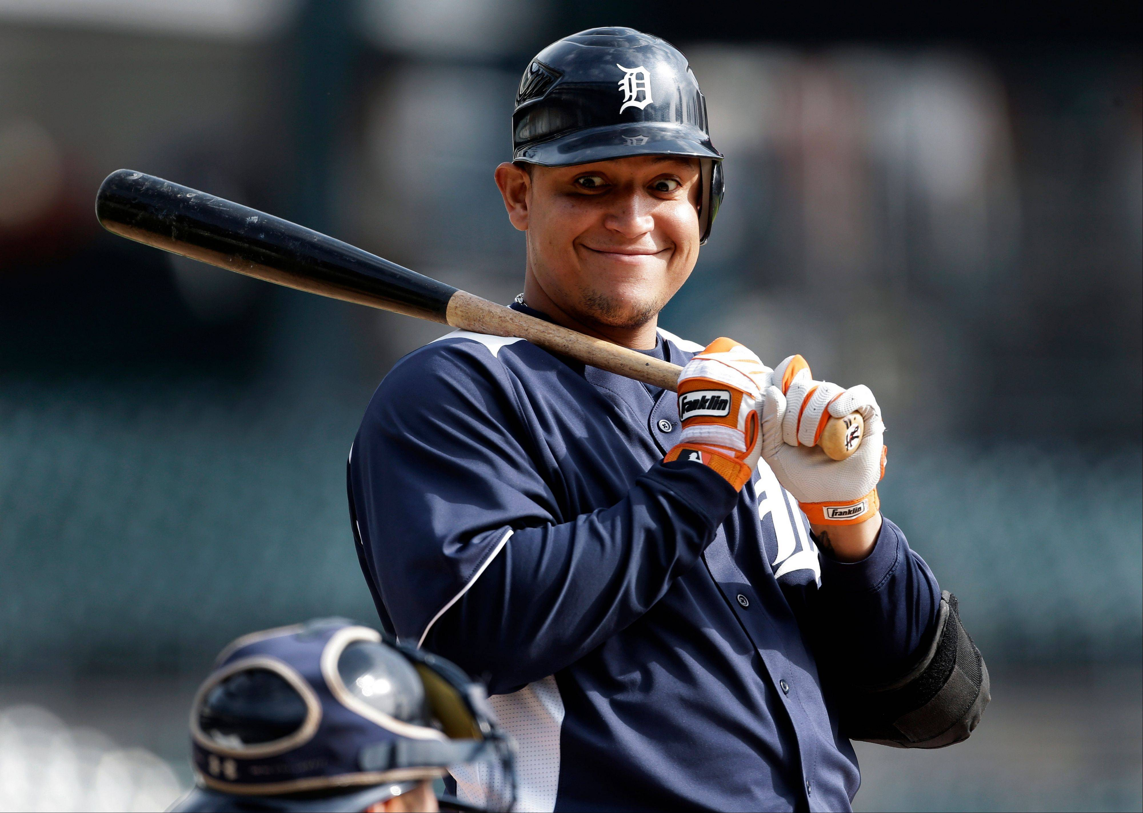 The Tigers' Miguel Cabrera smiles at catcher Gerald Laird after a pitch during a workout Monday at Comerica Park. Cabrera will be the first Triple Crown winner to play in the World Series since Carl Yastrzemski and Boston lost in 1967.
