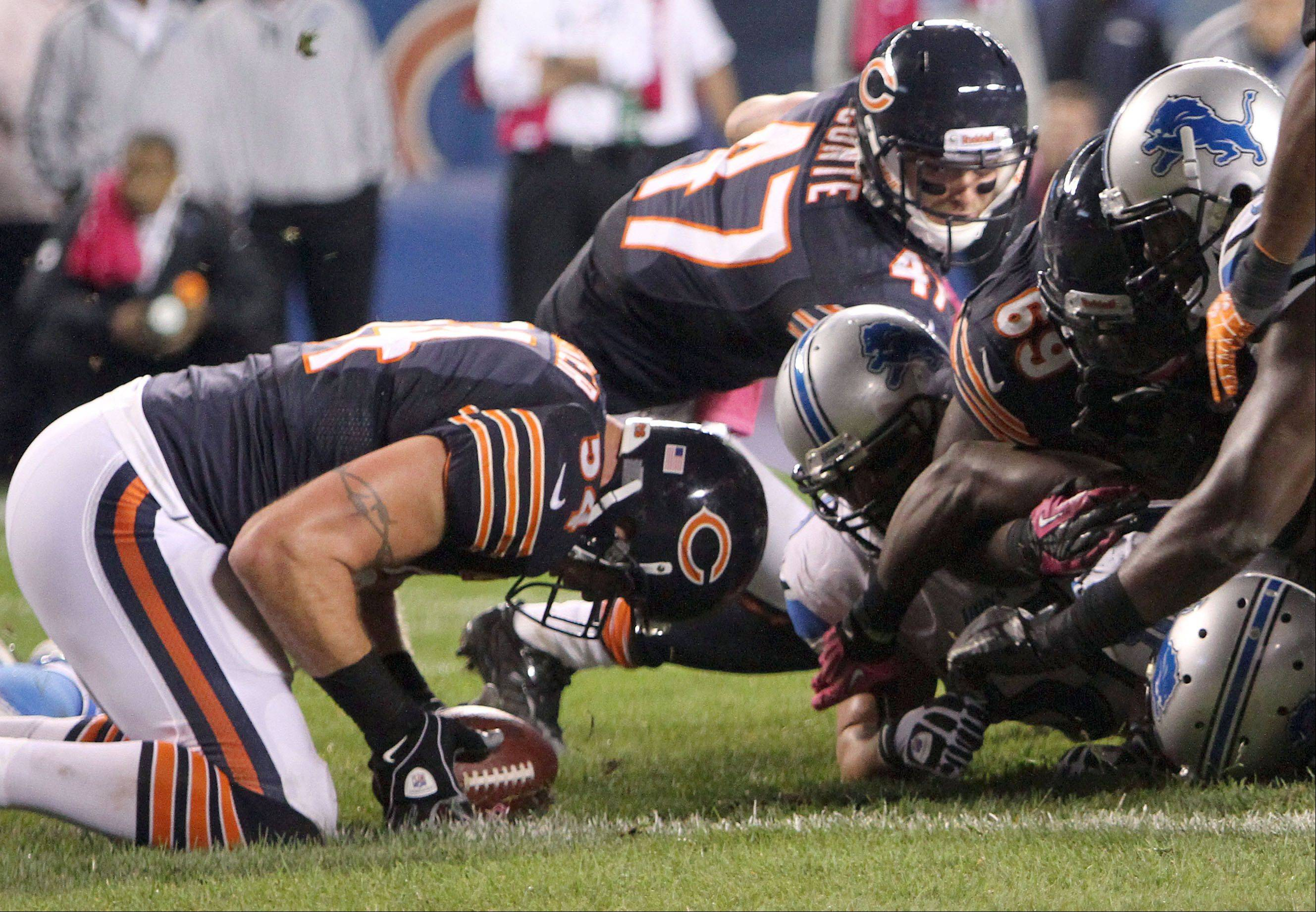 Chicago Bears middle linebacker Brian Urlacher recovers a fumble on the one-yard line Monday night, stopping a Lions drive in the third quarter in their game at Soldier Field.