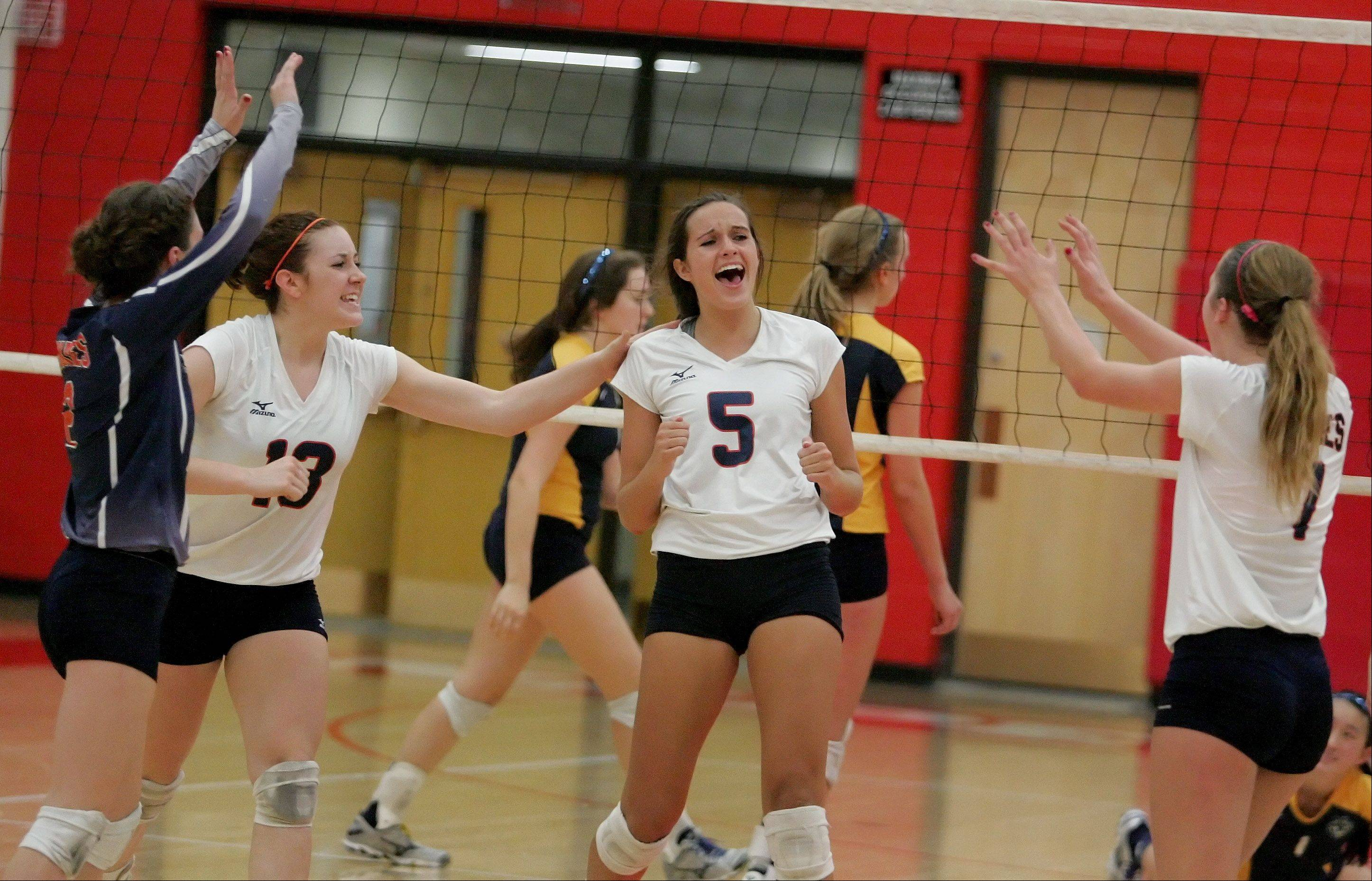 Naperville North reacts to a point won in their two-game win over Neuqua Valley in Class 4A girls volleyball regional semifinals at Naperville Central on Monday.
