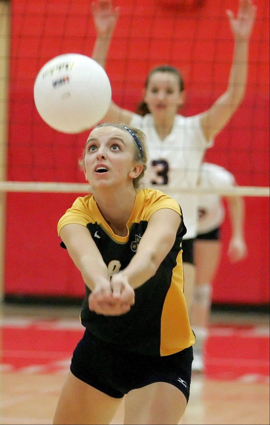 Brooke Antenen of Neuqua Valley bumps the ball in Class 4A girls volleyball regional semifinals against Naperville North at Naperville Central on Monday.