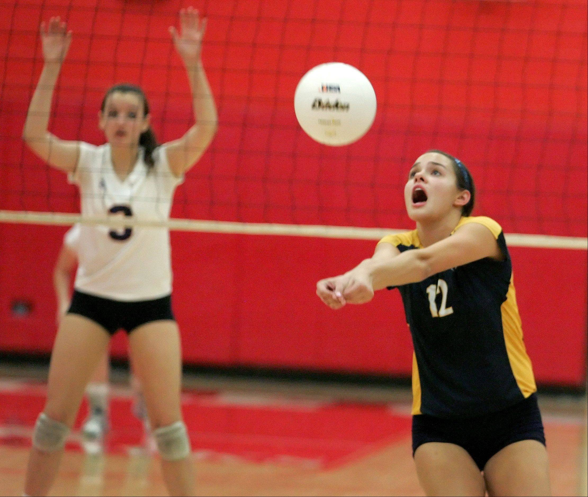 Kacie Florek of Neuqua Valley bumps the ball back to Naperville North in Class 4A girls volleyball regional semifinals at Naperville Central on Monday.