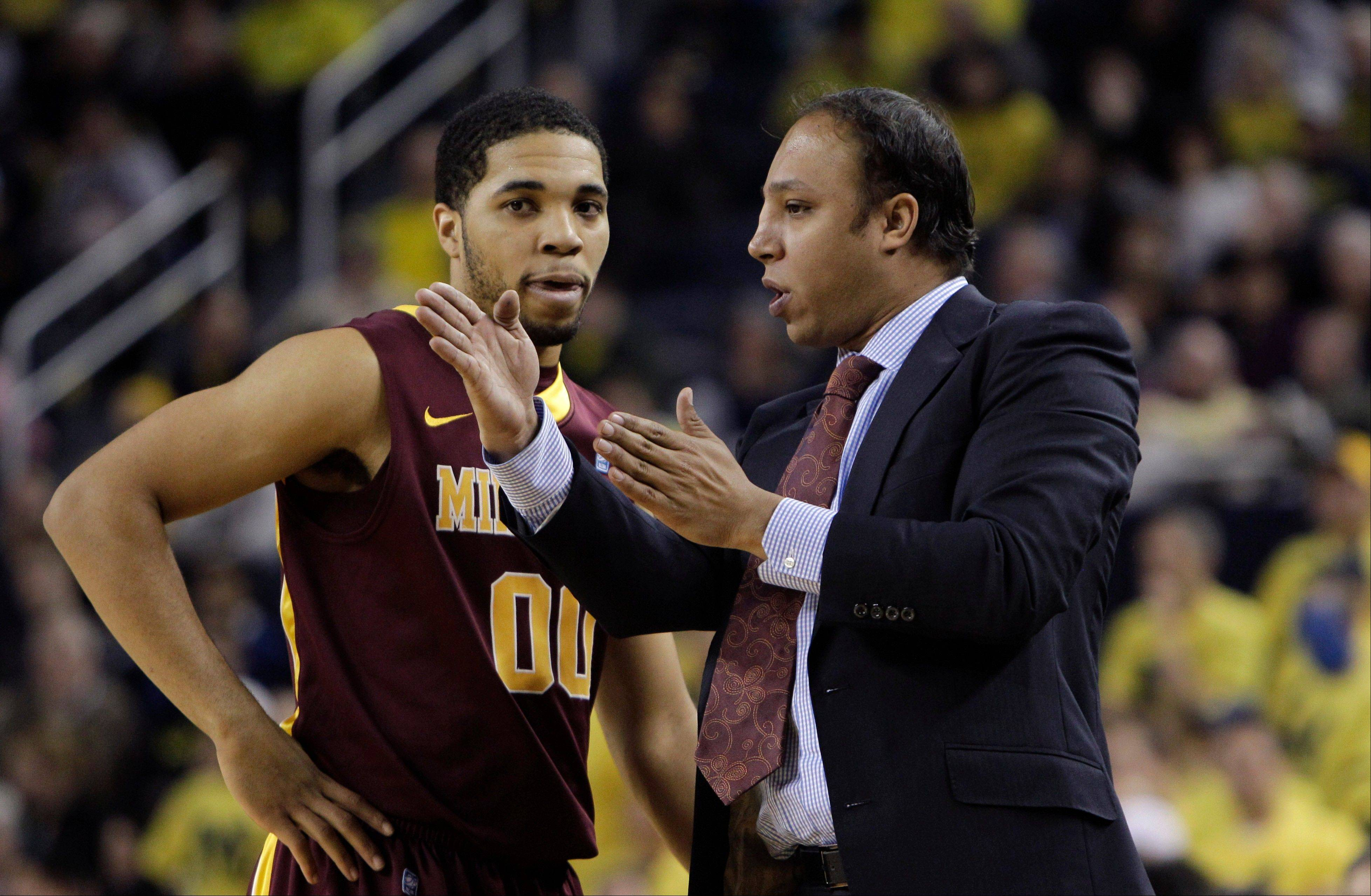 Minnesota assistant coach Saul Smith talks to guard Julian Welch during a game against Michigan last January in Ann Arbor, Mich. Smith is on indefinite leave after a weekend arrest on suspicion of drunken driving.