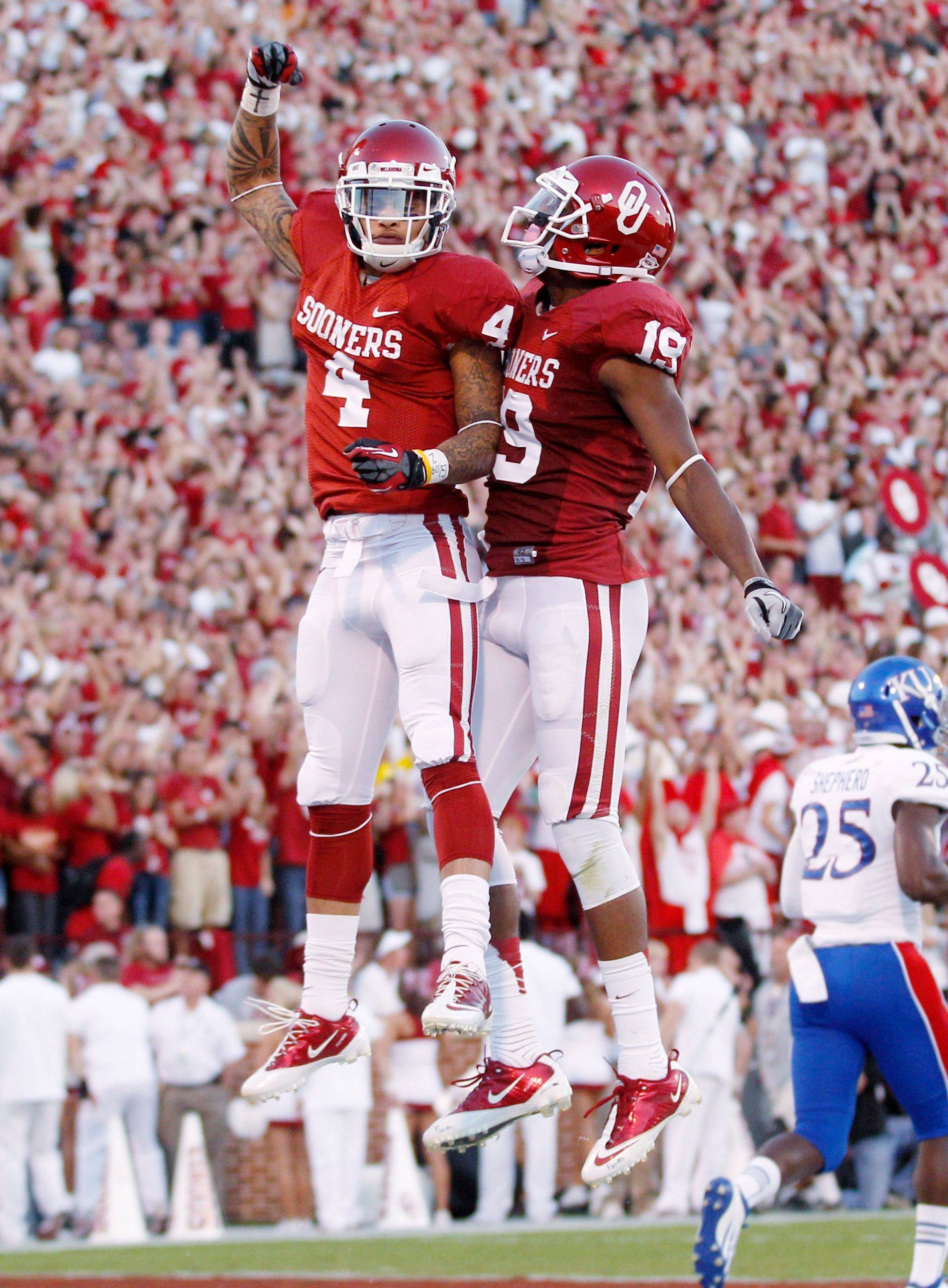 Oklahoma wide receivers Kenny Stills (4) and Justin Brown (19) celebrate following Stills' touchdown against Kansas on Saturday.