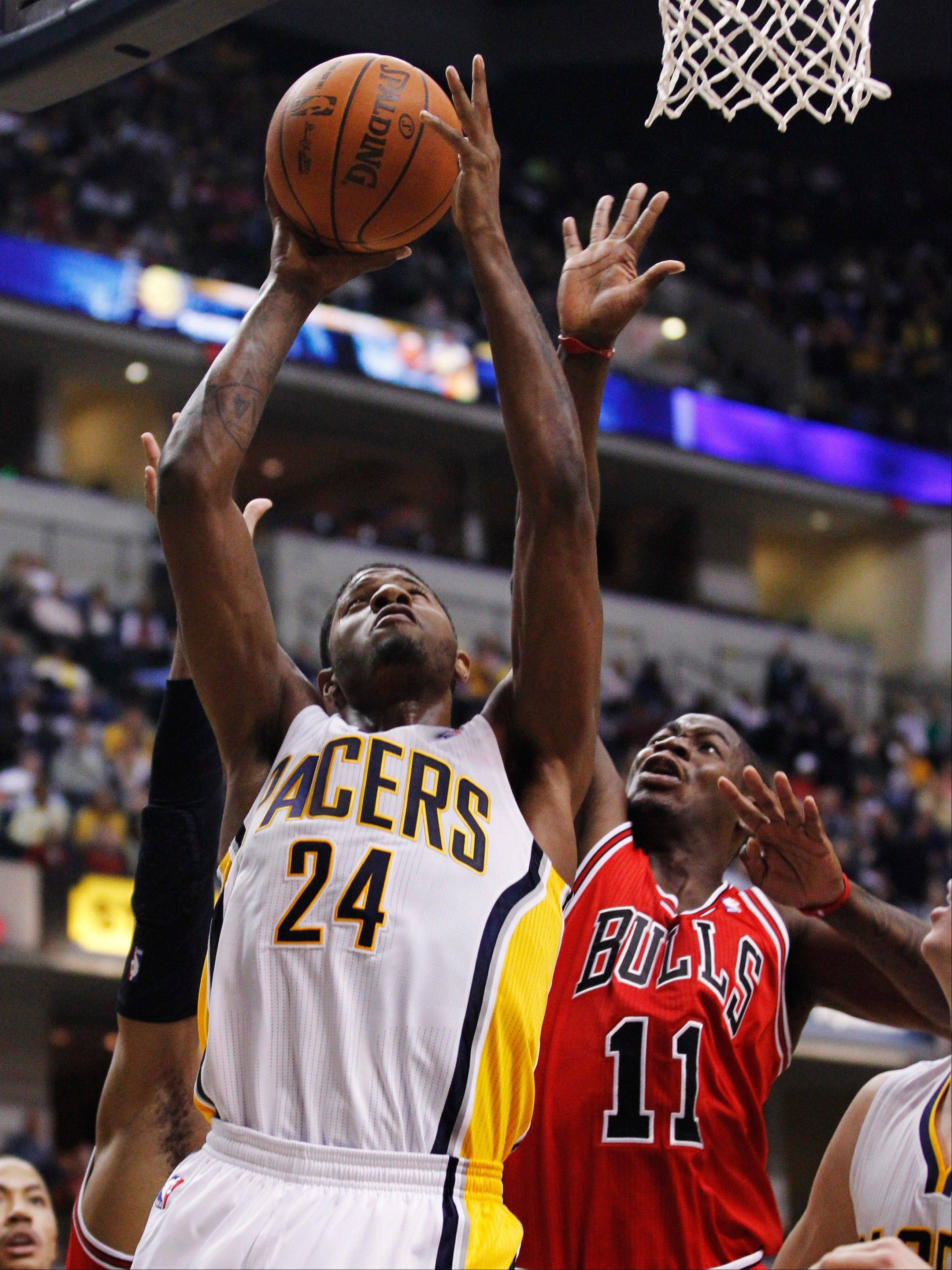 A survey of NBA GMs posits that the Indiana Pacers will win the Central Division this season. Indiana forward Paul George, left, is seen shooting under pressure from Bulls guard Ronnie Brewer in this game from last December.