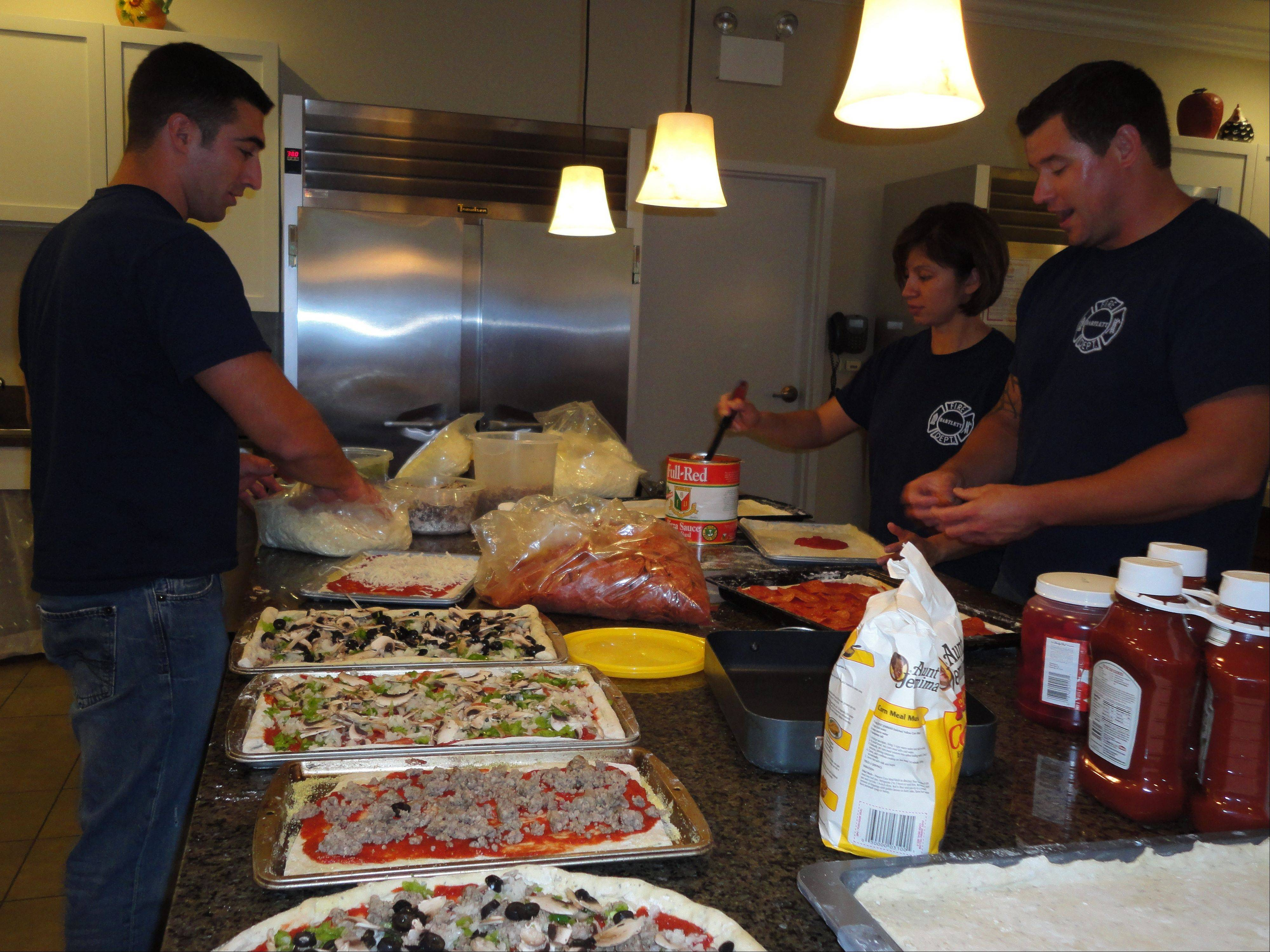 Members of the Bartlett Fire Protection District prepare a meal for the families staying at the Ronald McDonald House at the University of Chicago Comer Children's Hospital.