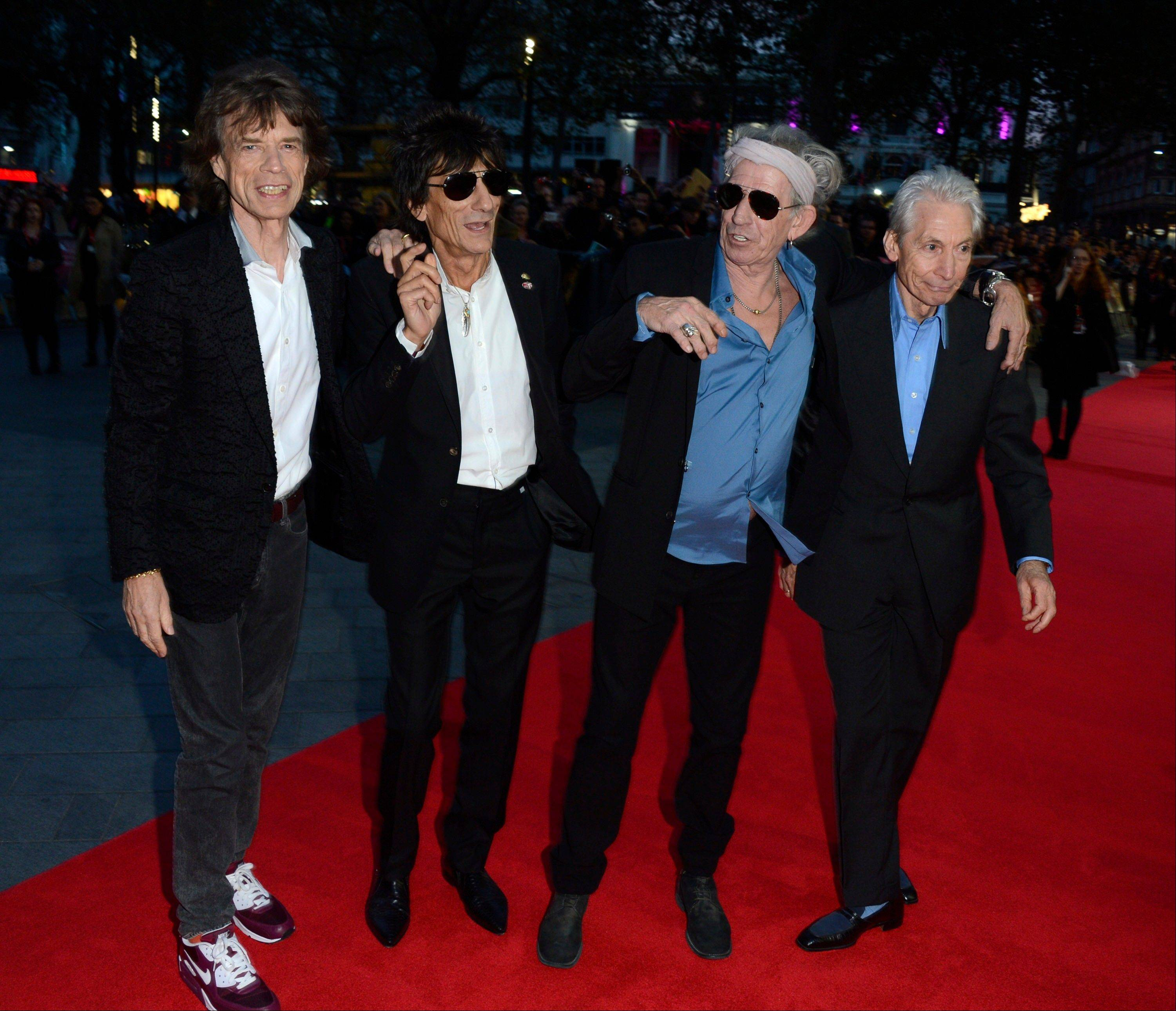 Mick Jagger, left, Ronnie Wood, Keith Richards and Charlie Watts of The Rolling Stones attend the London Film Festival American Express Gala for �Crossfire Hurricane� in London.