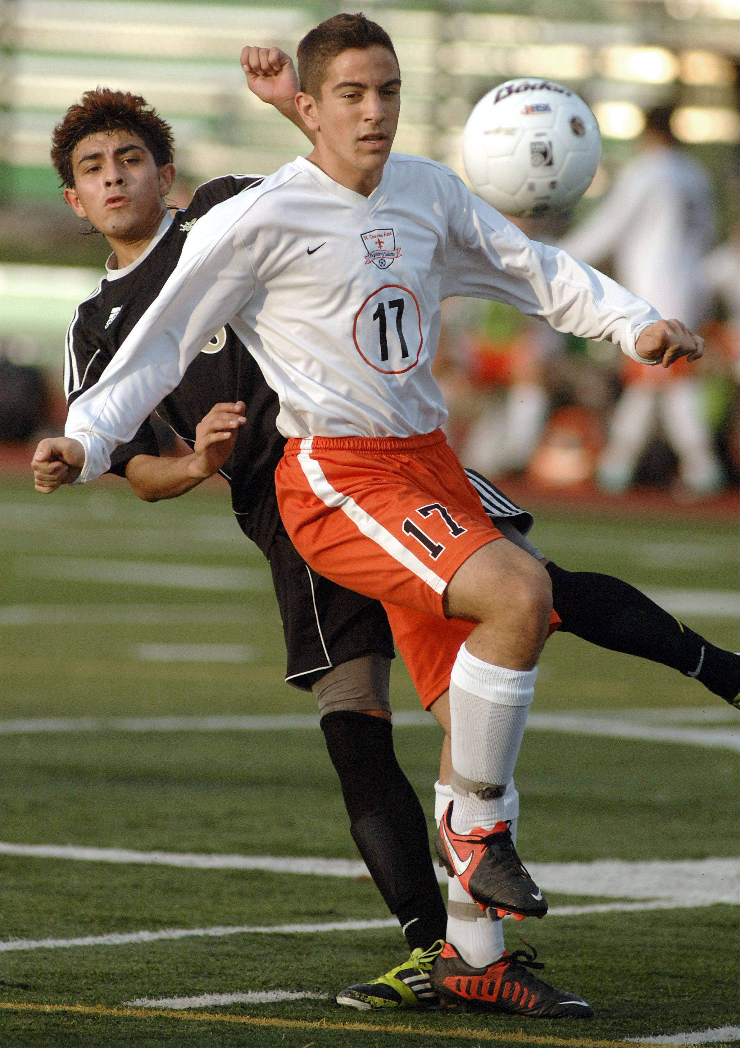 Streamwood�s Christian Vences and St. Charles East�s Brad Corirossi fight for the ball in the first half on Tuesday at the York sectional.