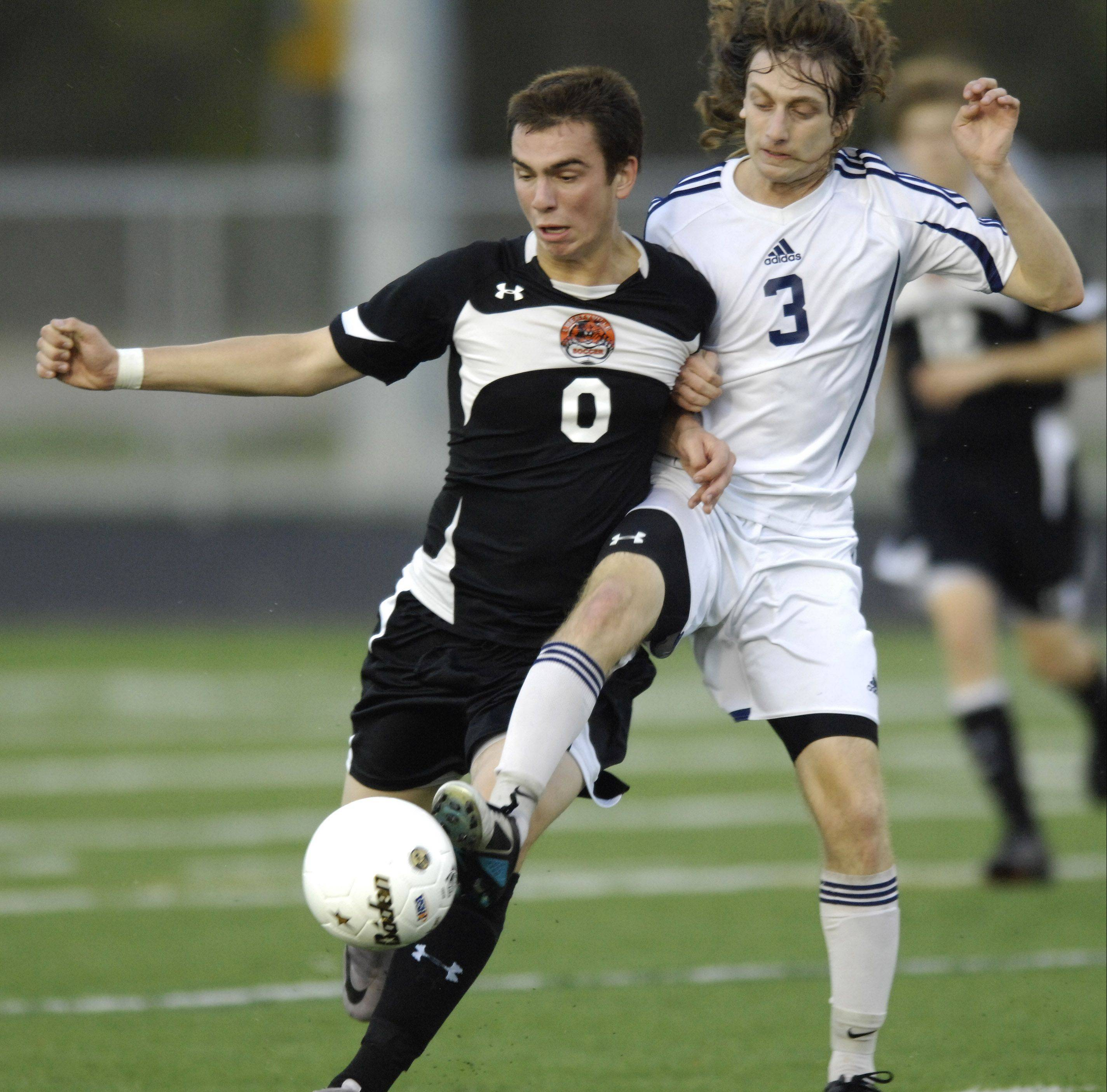 Libertyville�s Austin Bitta, left, and Prospect�s Avi Chitman make contact as they pursue the ball during Tuesday�s sectional semifinal at Conant.