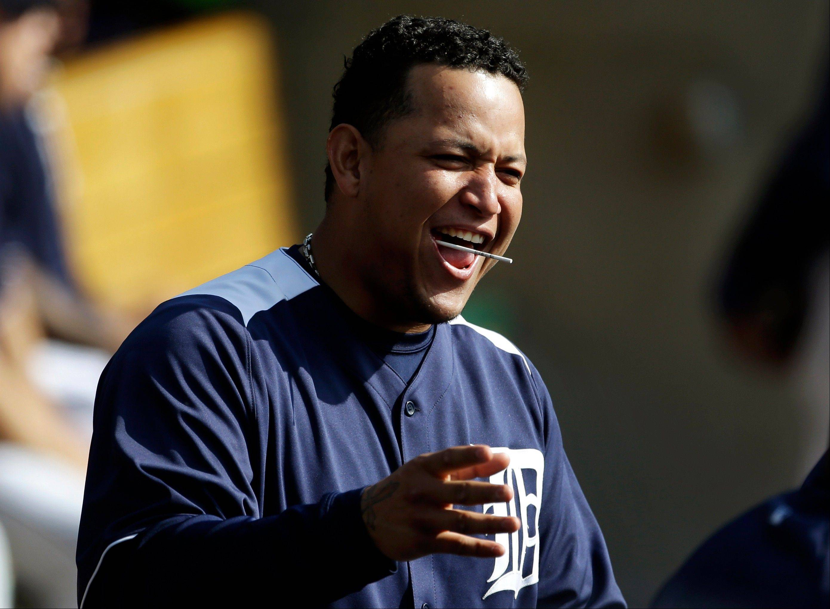 The Detroit Tigers� Miguel Cabrera laughs in the dugout during a workout Monday at Comerica Park in Detroit. Cabrera is one of 9 Venezuelans playing for the Tigers and Giants in the World Series.