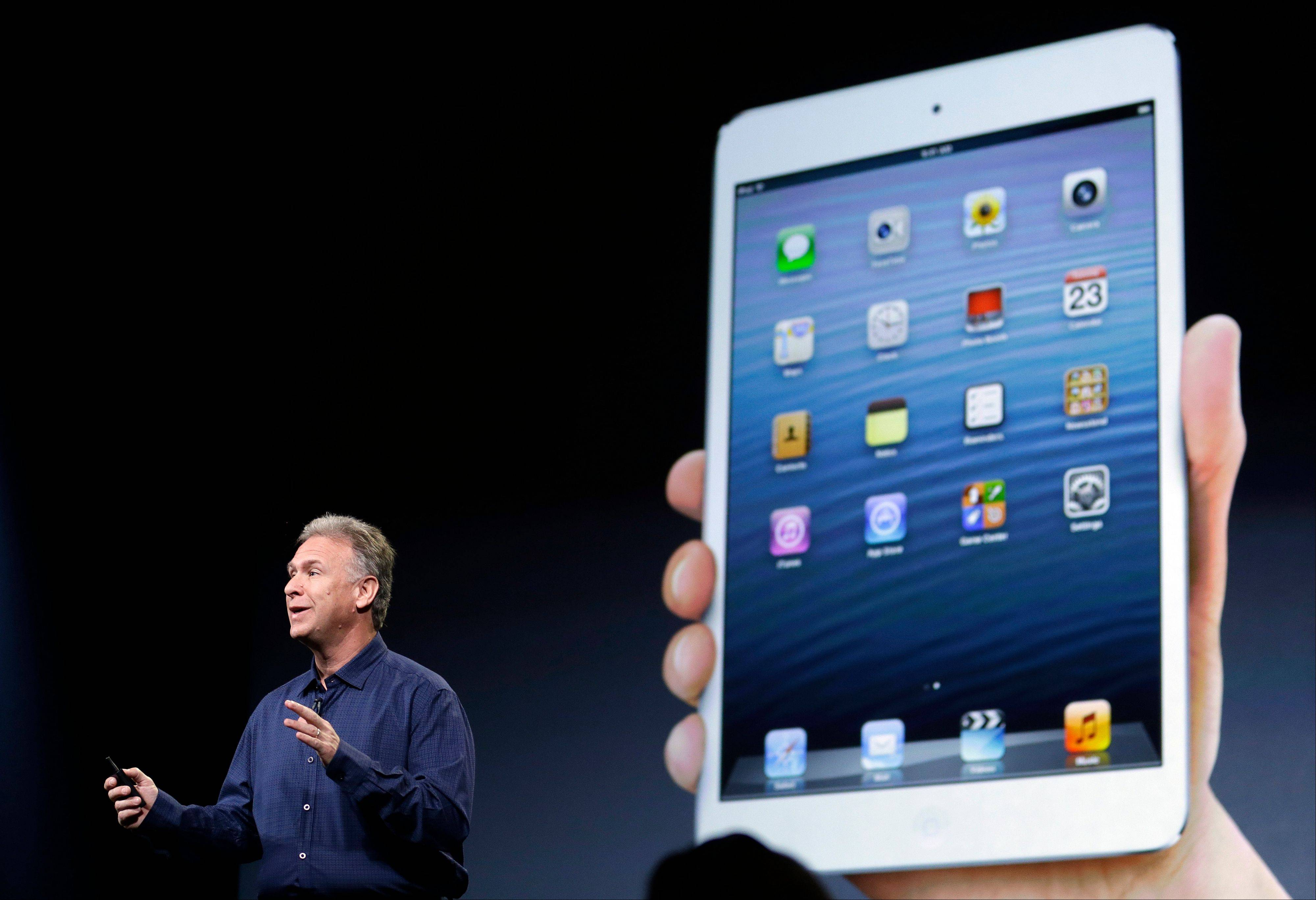 Phil Schiller, Apple's senior vice president of worldwide product marketing, introduces the iPad mini in San Jose, Calif., Tuesday. Apple Inc. is refusing to compete on price with its rivals in the tablet market. It's pricing its new, smaller iPad well above the competition.