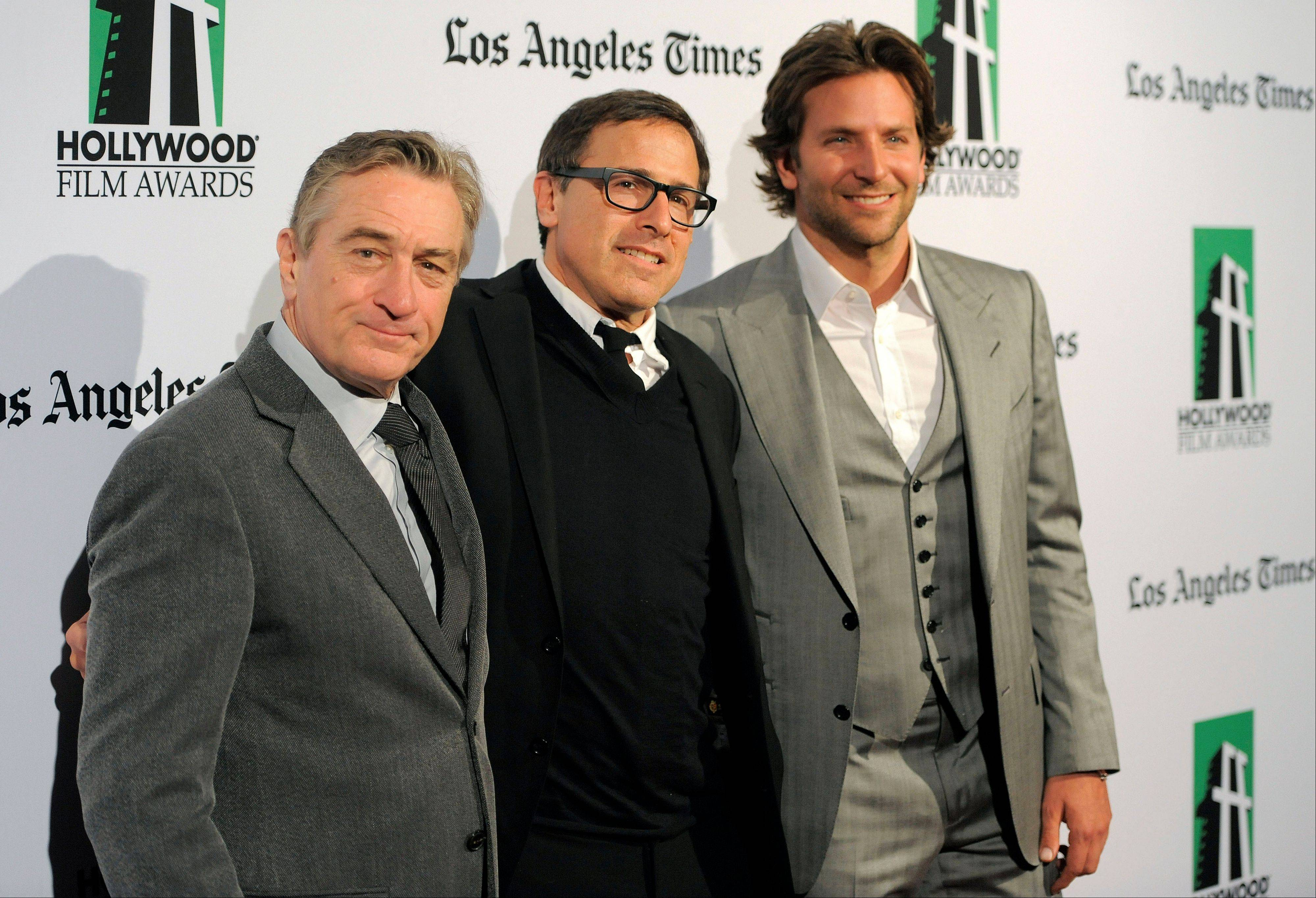 Robert De Niro, left, recipient of the Hollywood Supporting Actor Award, David O. Russell, center, recipient of the Hollywood Director Award, and Bradley Cooper, recipient of the Hollywood Actor Award, at the 16th Annual Hollywood Film Awards Gala on Monday.