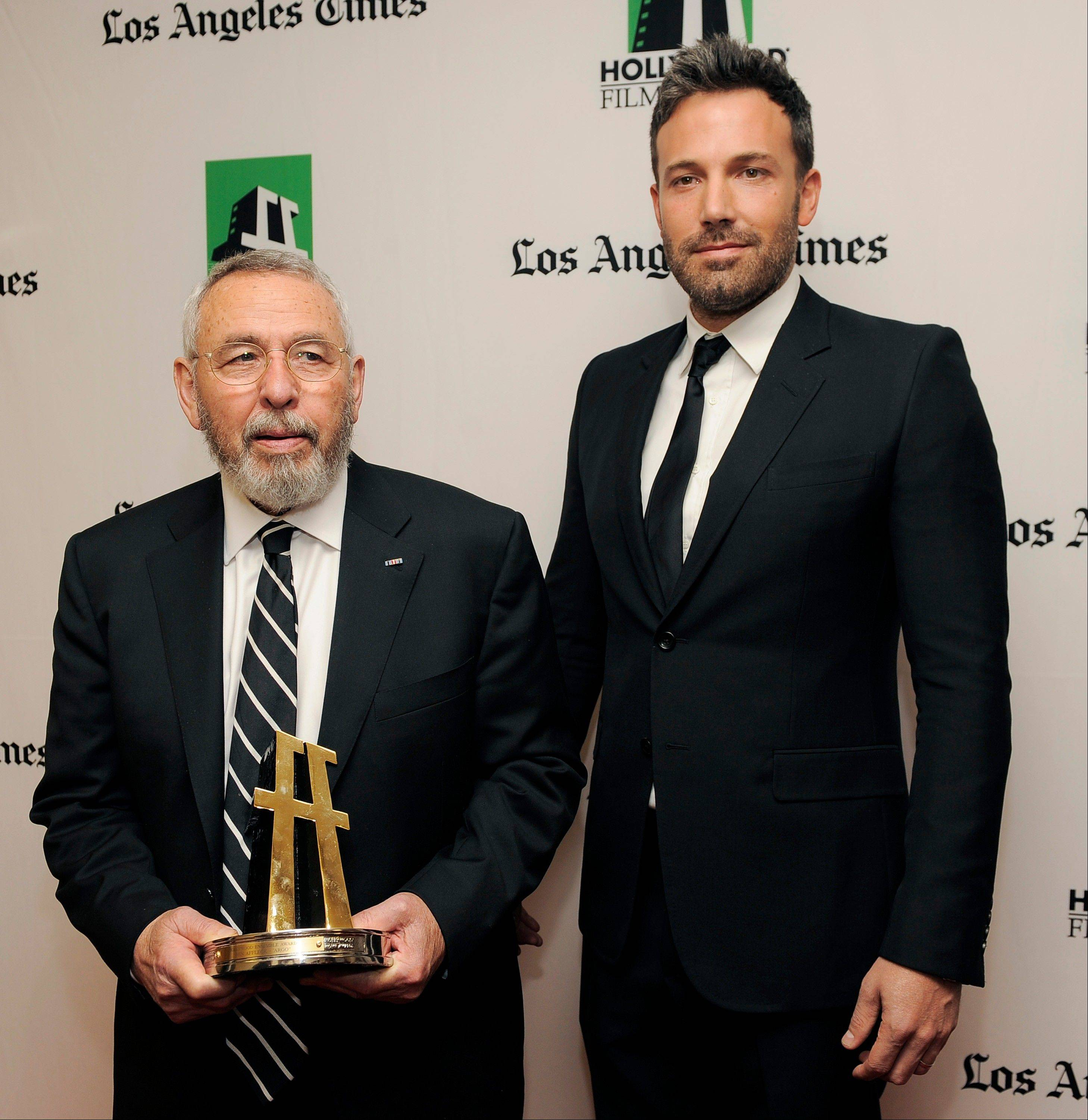 "Ben Affleck, right, a cast member and director of the film ""Argo,"" with former C.I.A. agent Tony Mendez, whom he portrays in the film, backstage at the 16th Annual Hollywood Film Awards Gala."