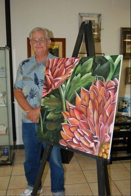 "Artist Jim Schnaitman is shown with ""Mums,"" an oil on canvas painting now on display at Gallery 20 in West Chicago."