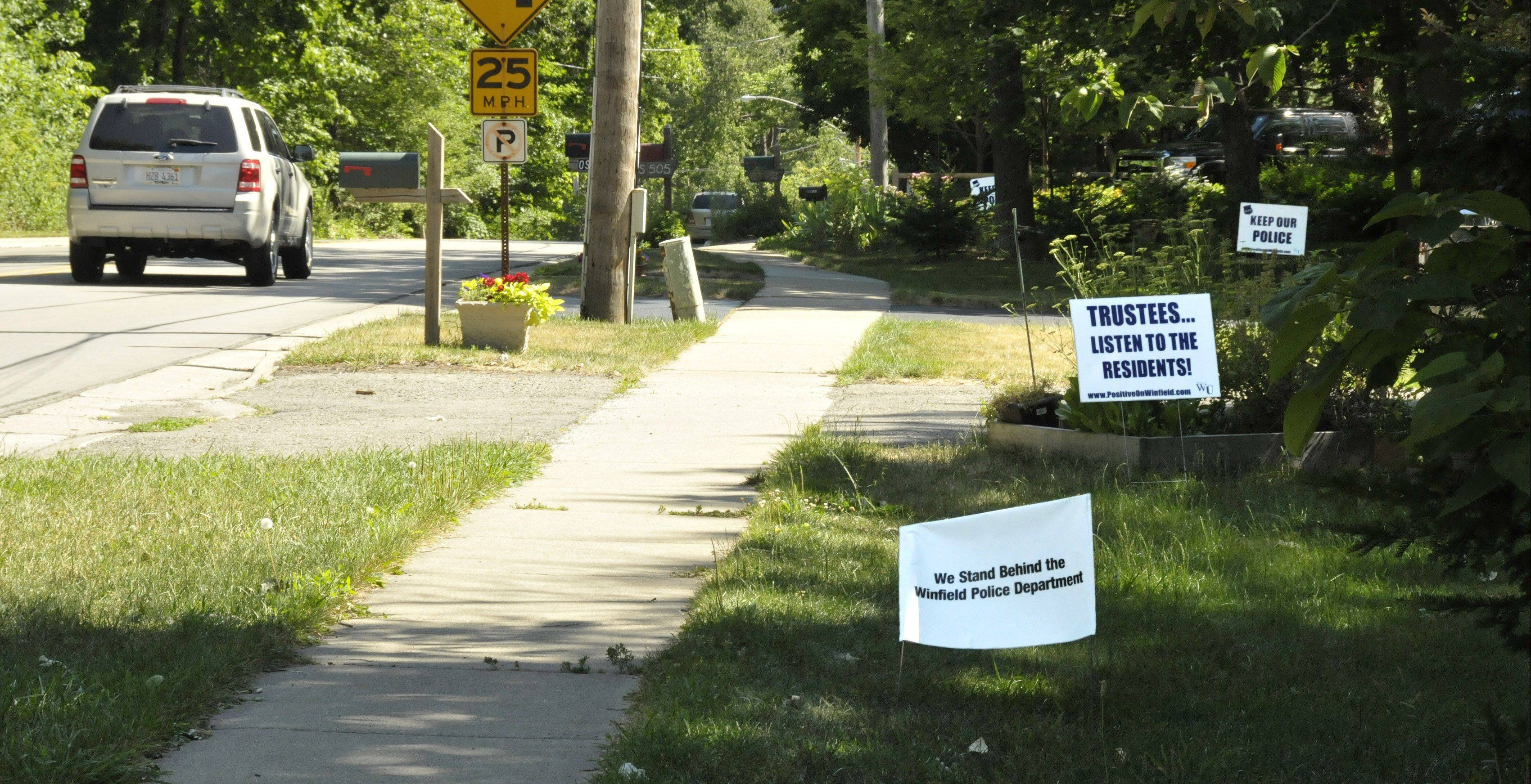 Winfield residents, many of whom have posted signs in support of keeping the village police department intact, will vote Nov. 6 on whether they're willing to pay higher property taxes to prevent the disbanding of the department to pay for road repairs.