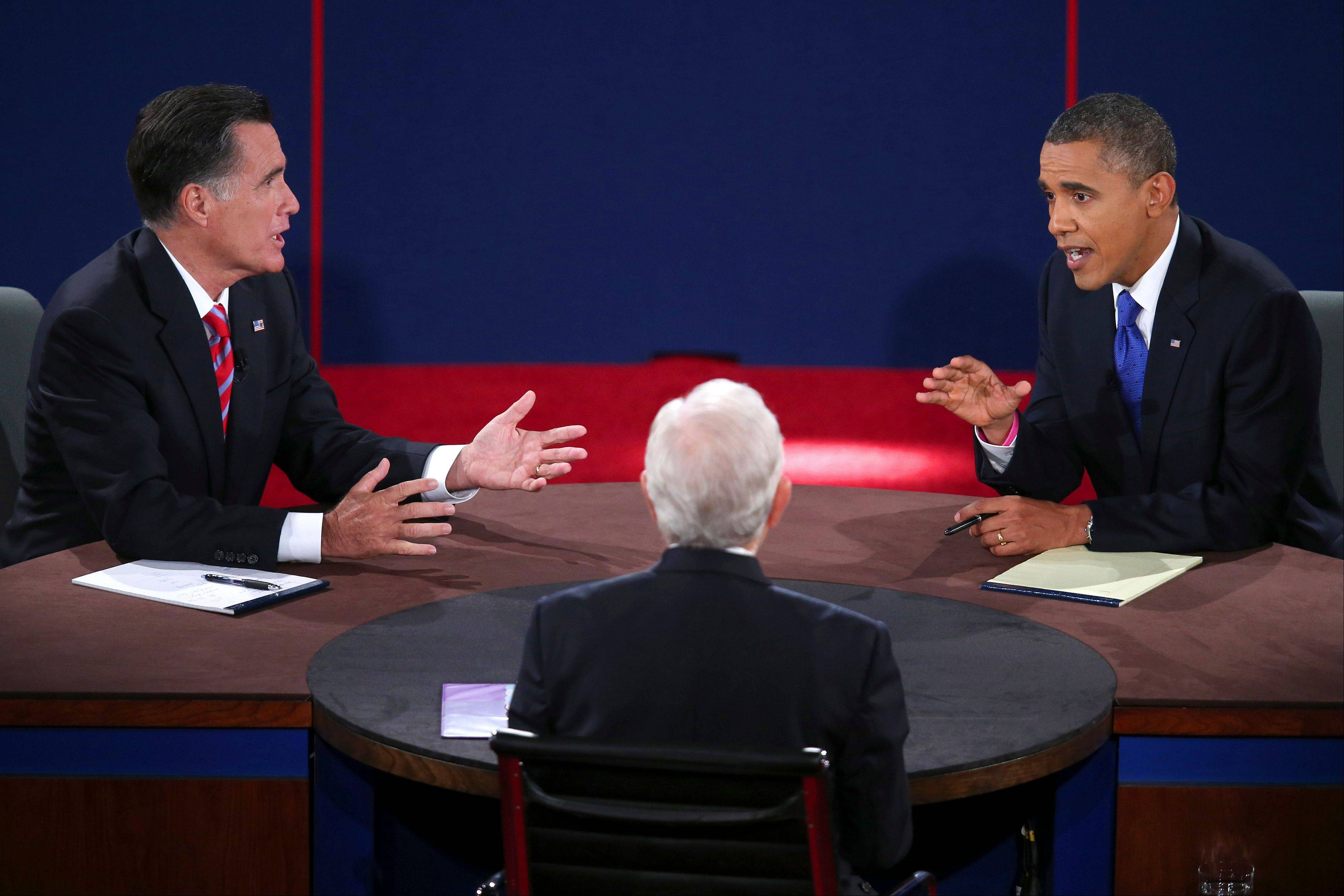 Republican presidential nominee Mitt Romney and President Barack Obama answer a question from moderator Bob Schieffer during the third presidential debate Monday at Lynn University in Boca Raton, Fla.