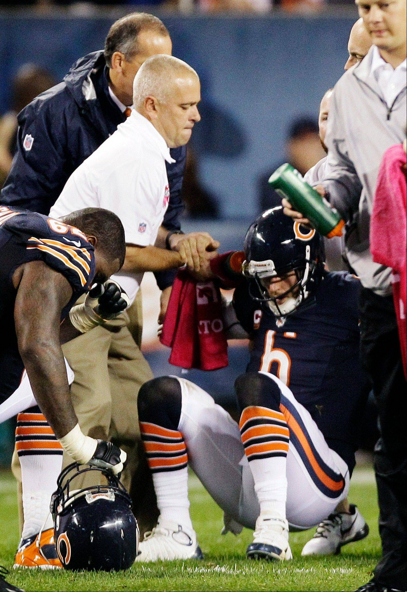 Bears quarterback Jay Cutler is helped up from the field after he was sacked by Detroit defensive tackle Ndamukong Suh in the first half of Monday's game at Soldier Field.