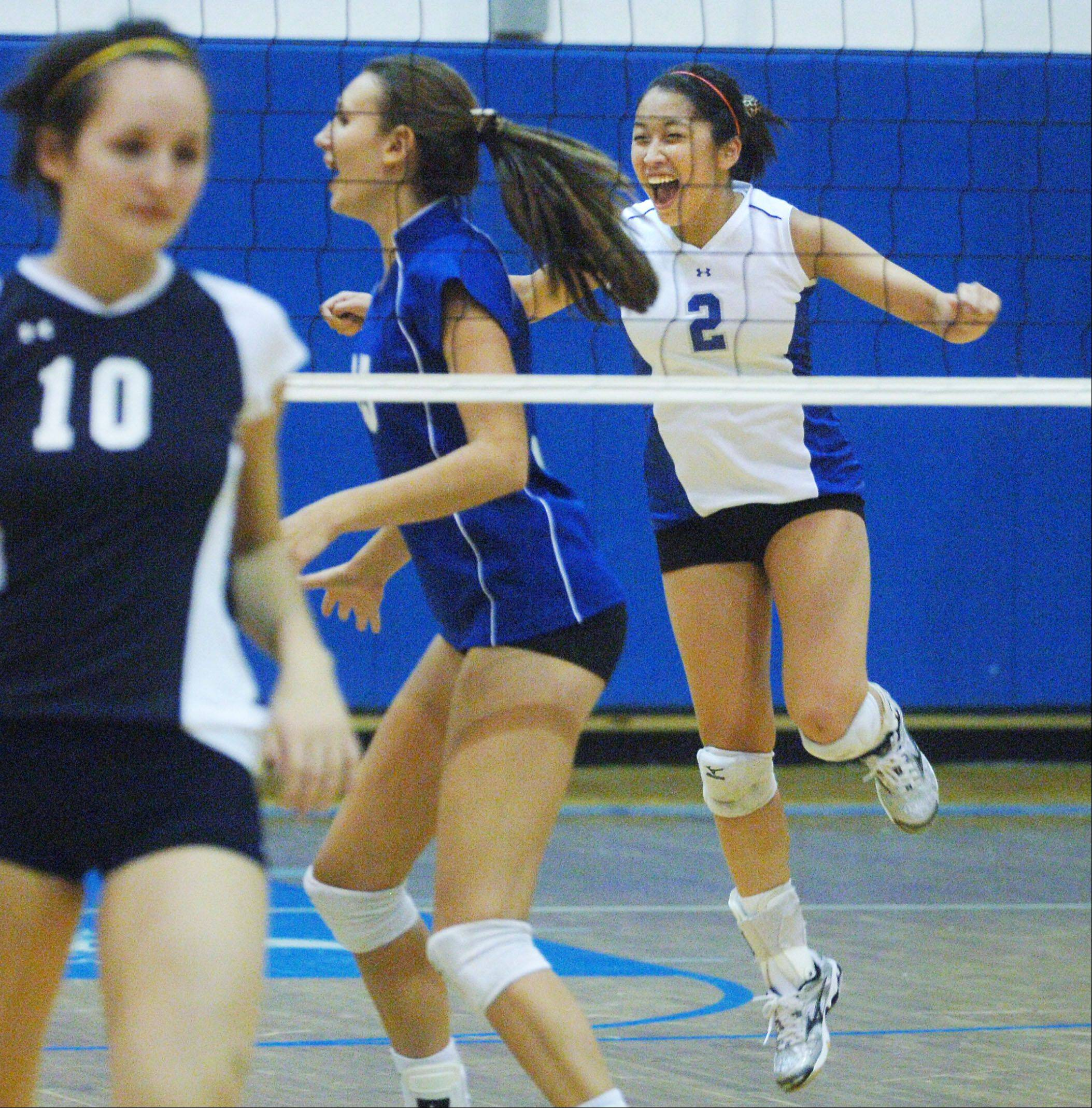 Amy Choi (2), here celebrating a point during her high school days, is a standout libero at Lewis University.