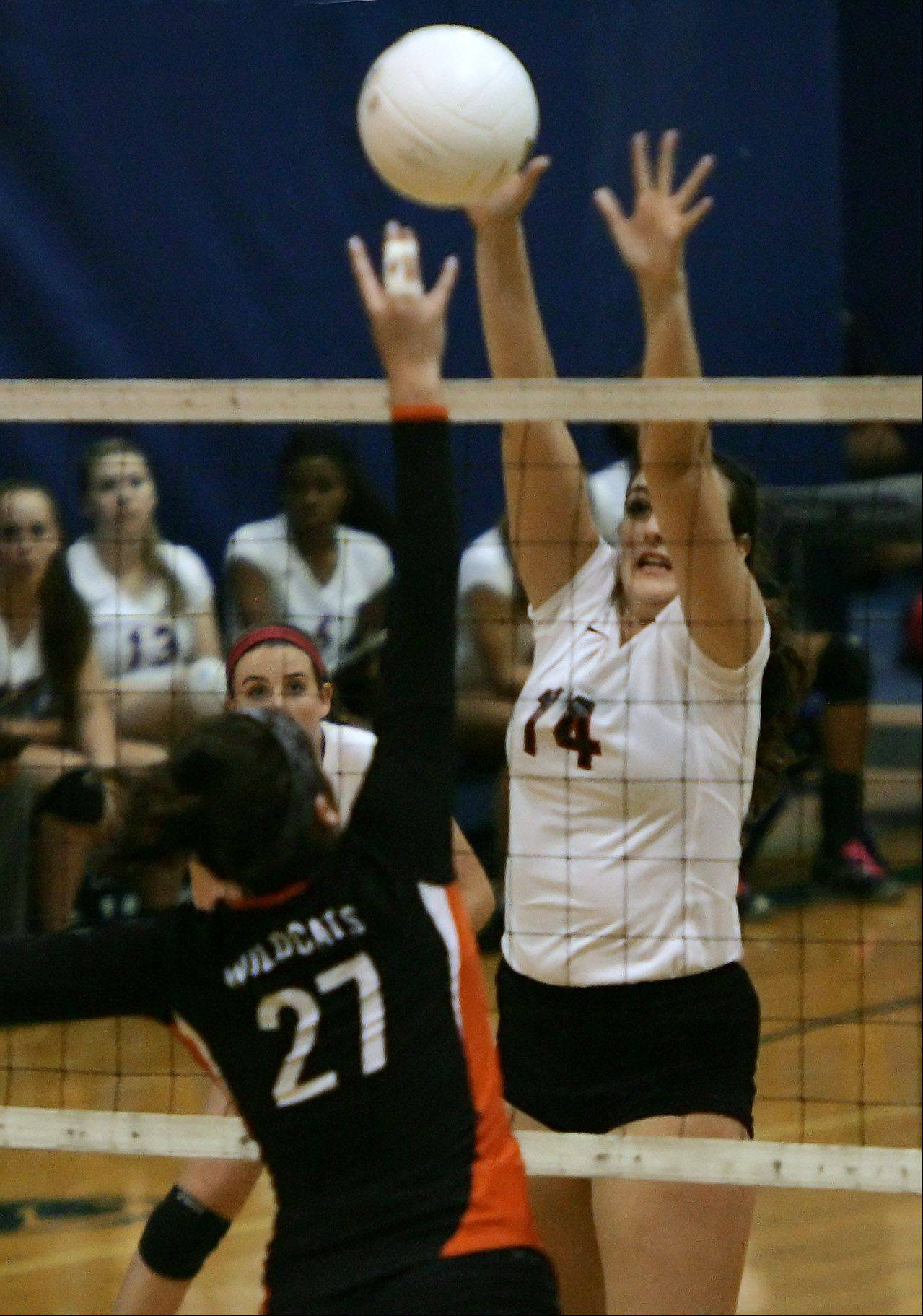 Mundelein defender Ashley Dolin blocks the shot of Libertyville's Francesca Fusco during Class 4A girls volleyball regional semifinal play Tuesday at Lake Zurich.