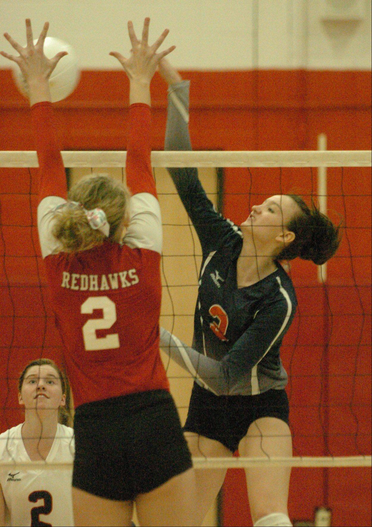 Phoebe Havenaar of Naperville Central goes up for a block as Angela Jurek spkies the ball durimng the Naperville Central vs. Naperville North girls volleyball at Naperville Central Tuesday.