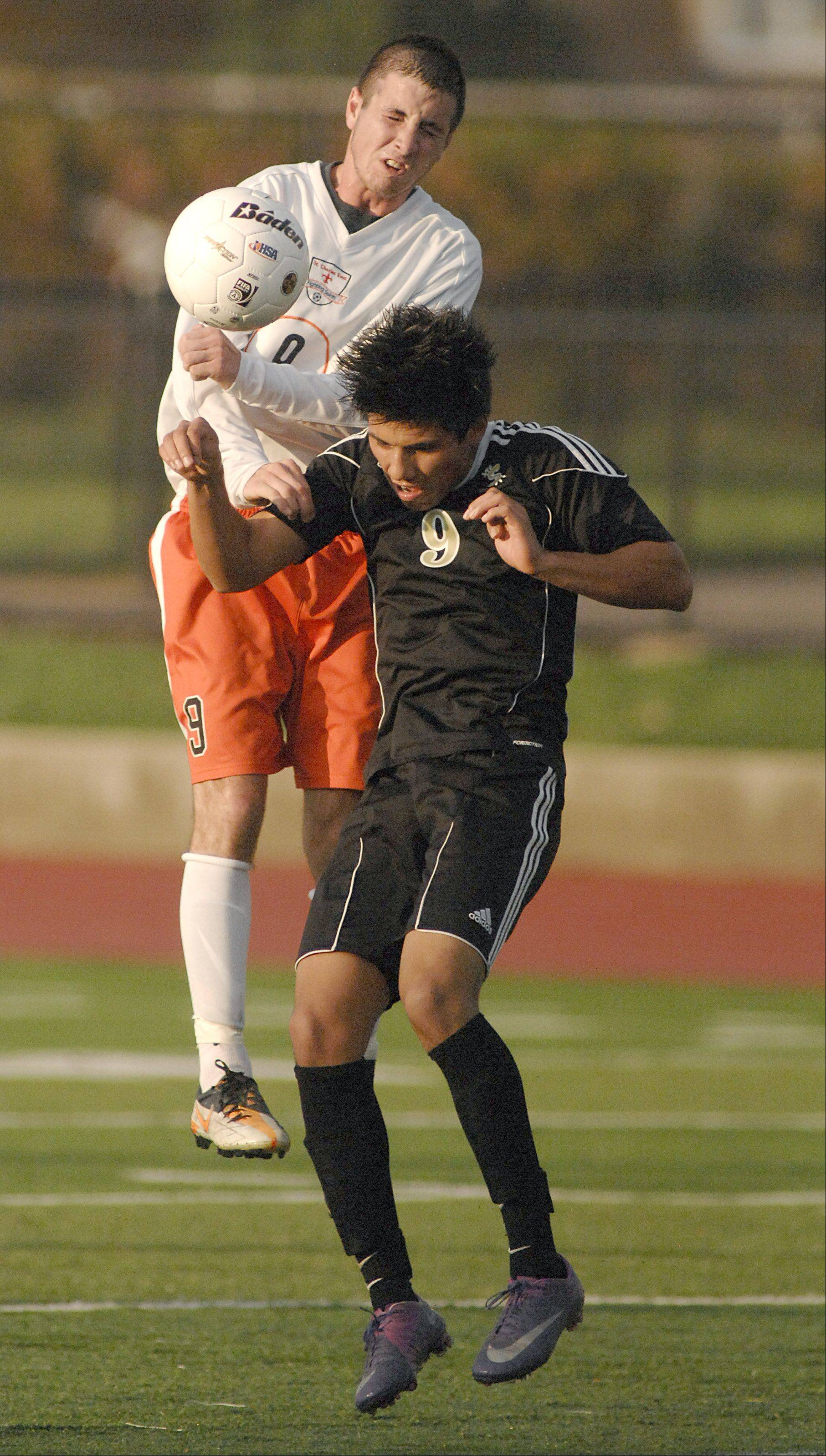 Streamwood's Mario Rodriguez and St. Charles East's Brian Gielow collide in the first half on Tuesday, October 23.
