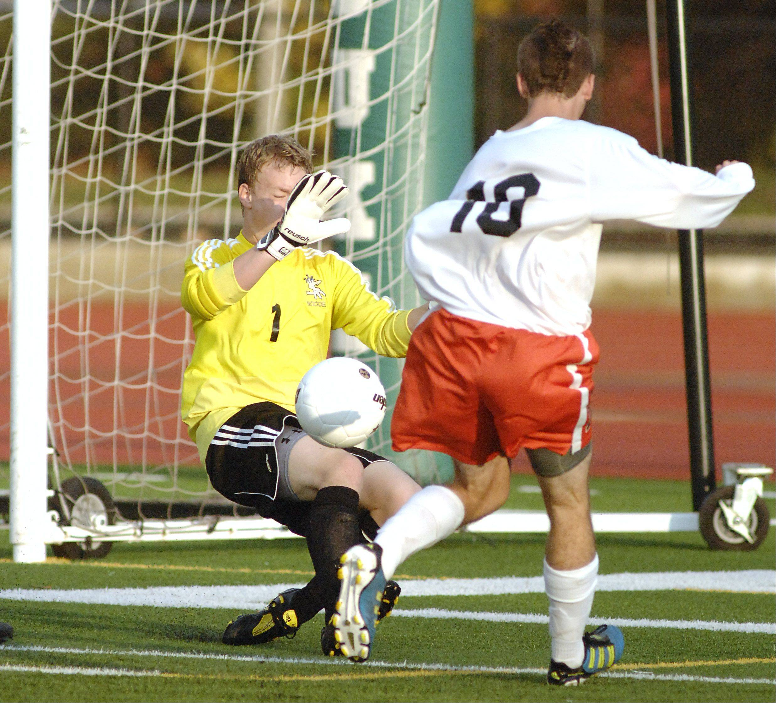 A goal kick by St. Charles East's T.C. Hull slips just past Streamwood's Phil Lewy resulting in a goal for the Saints in the first half on Tuesday, October 23.