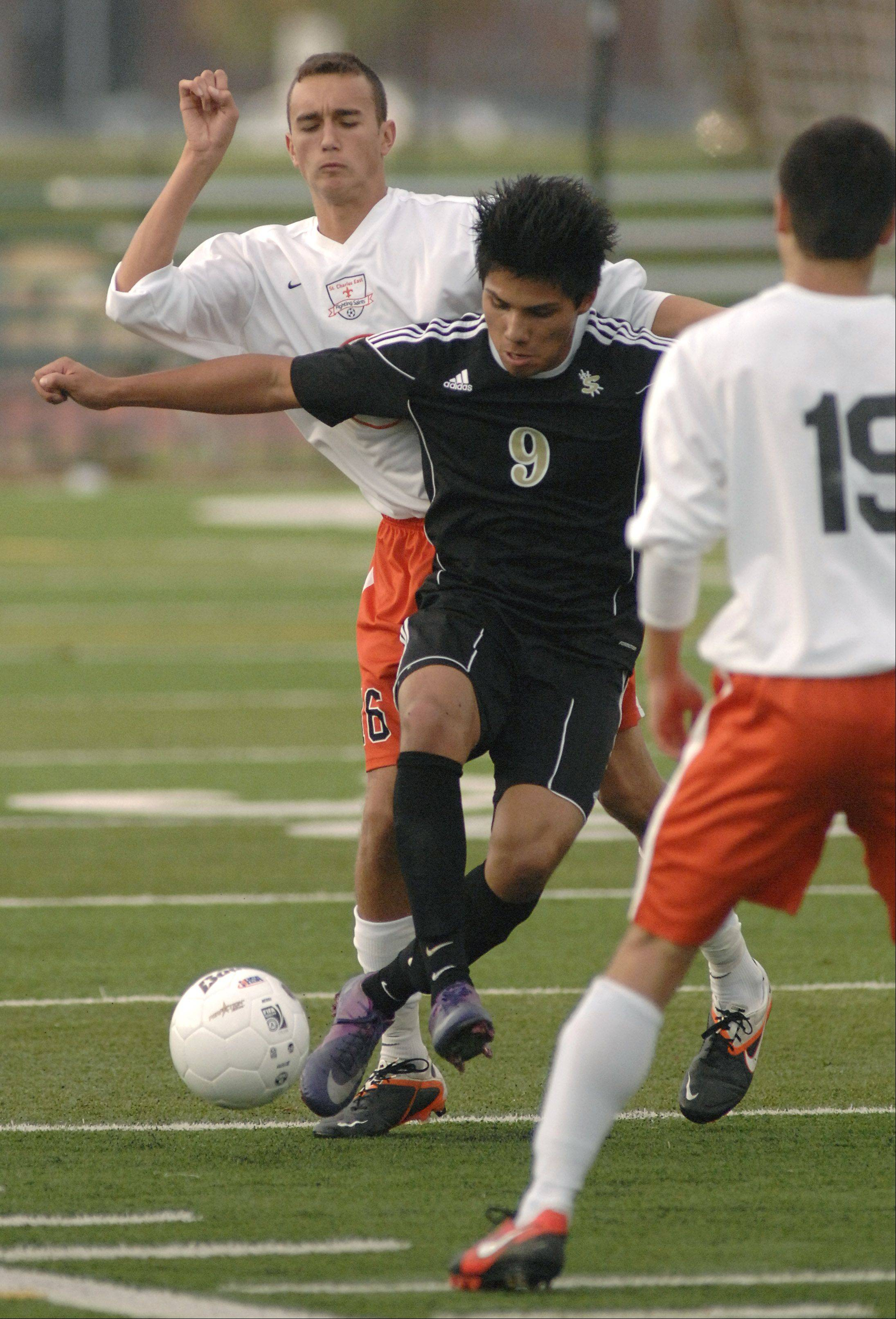 Streamwood's Mario Rodgriguez and St. Charles East's Jordan Moore fight for the ball in the first half on Tuesday October 23. 16 9 first