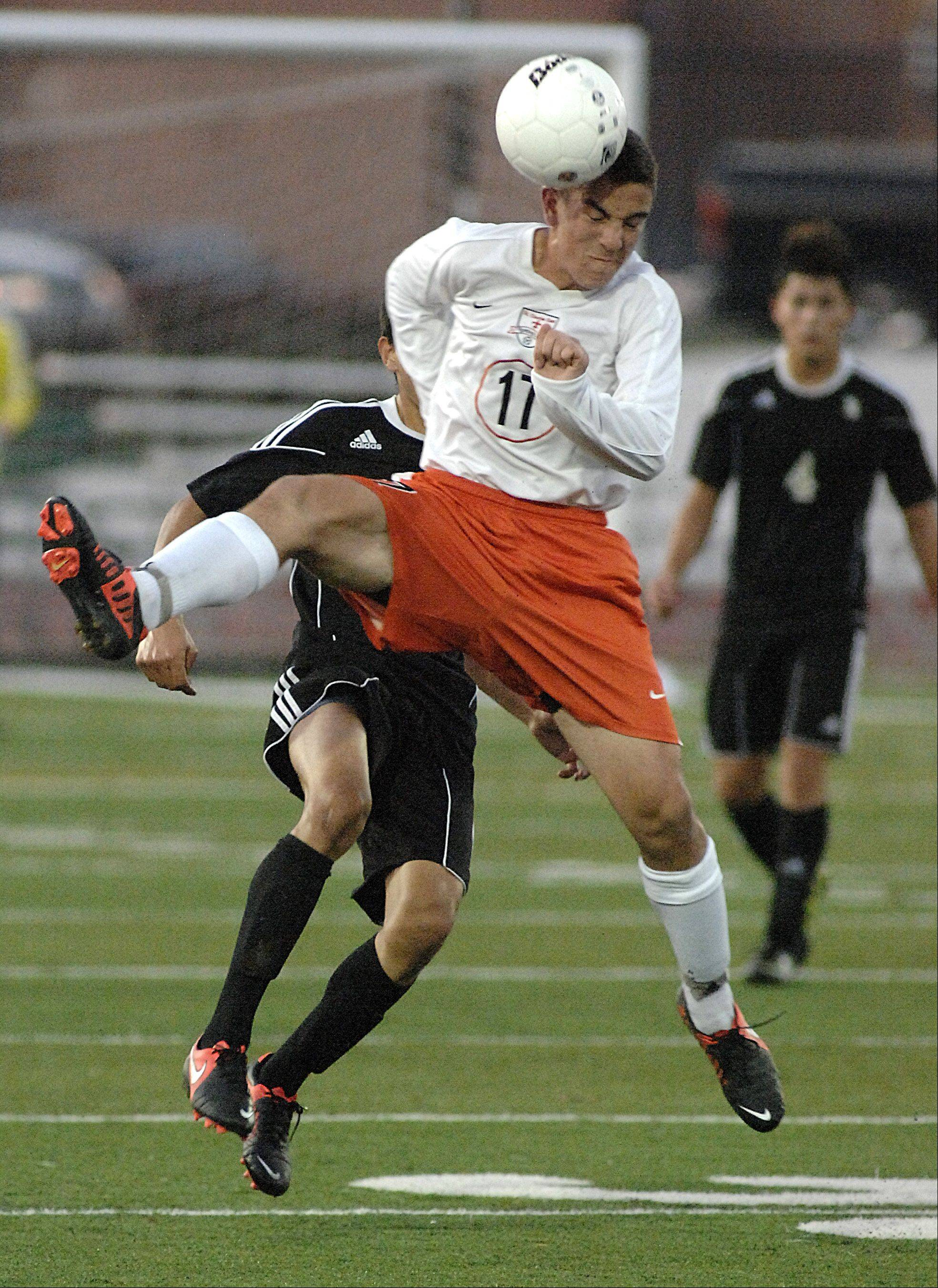 St. Charles East's Brad Corirossi burst in front of Streamwood's Daniel Nevarez to steal the ball in the second half on Tuesday, October 23.