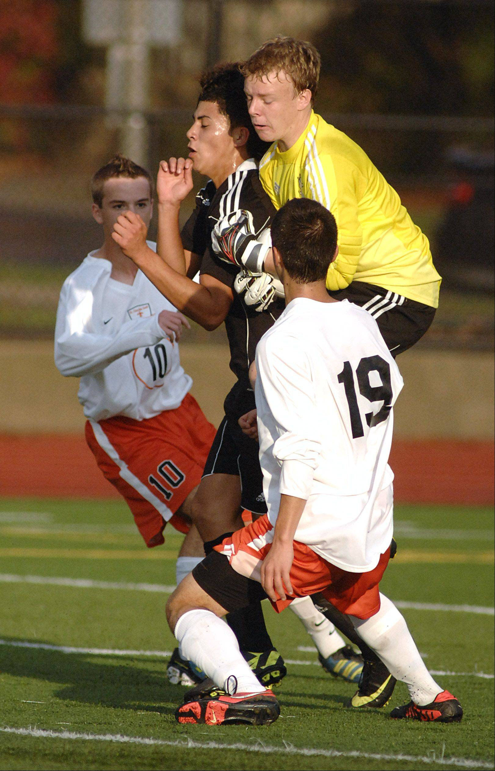 Streamwood goalkeeper Phil Lewy jumps in to save the ball from a goal in the first half on Tuesday, October 23.