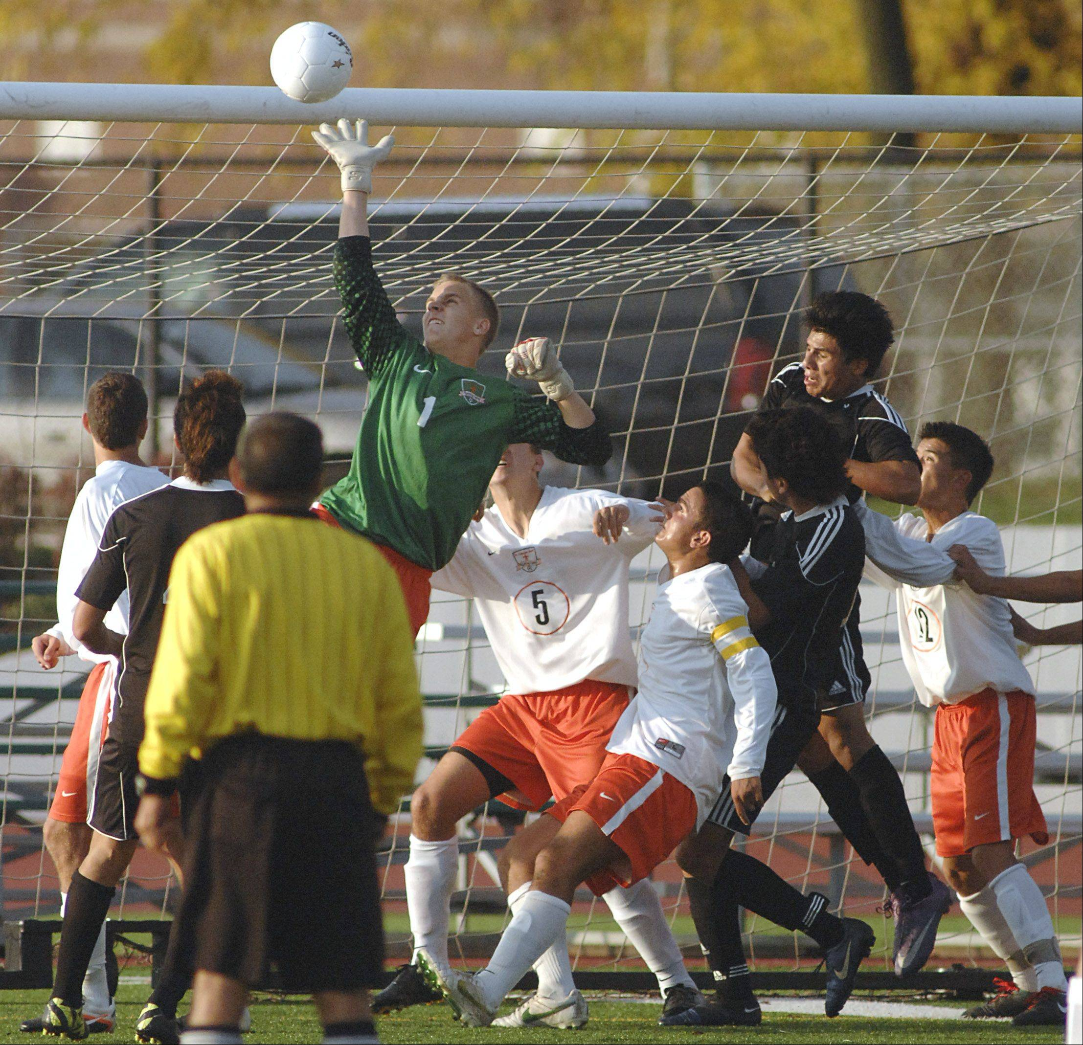St. Charles East goalie Mike Novotny deflects an attempt on the goal by Streamwood in the first half on Tuesday, October 23.